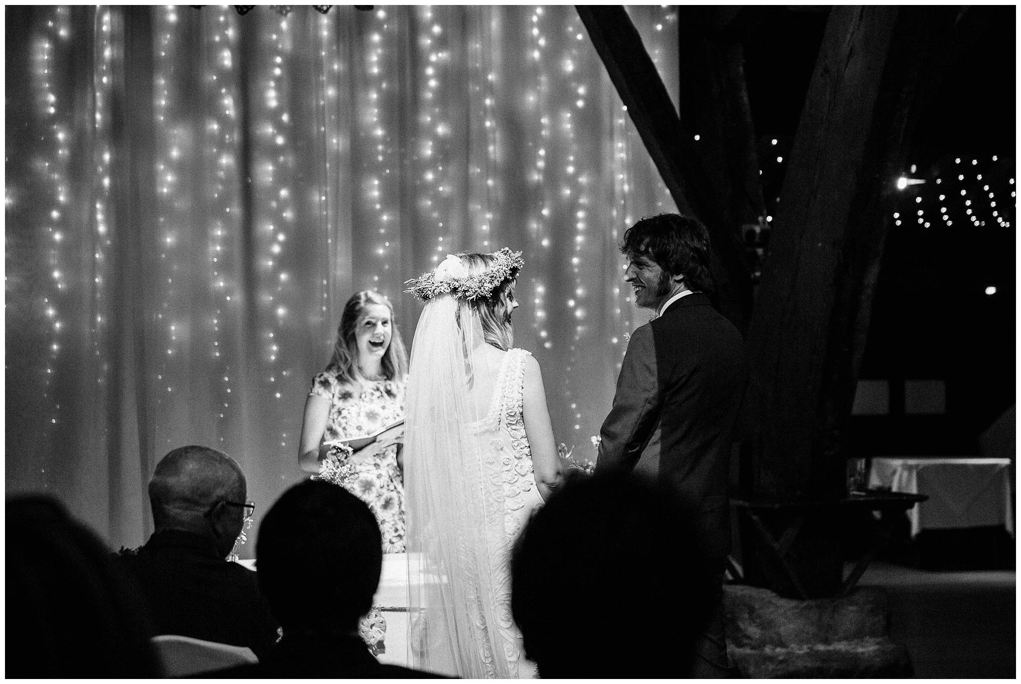 bride and groom looking at each other lovingly during ceremony