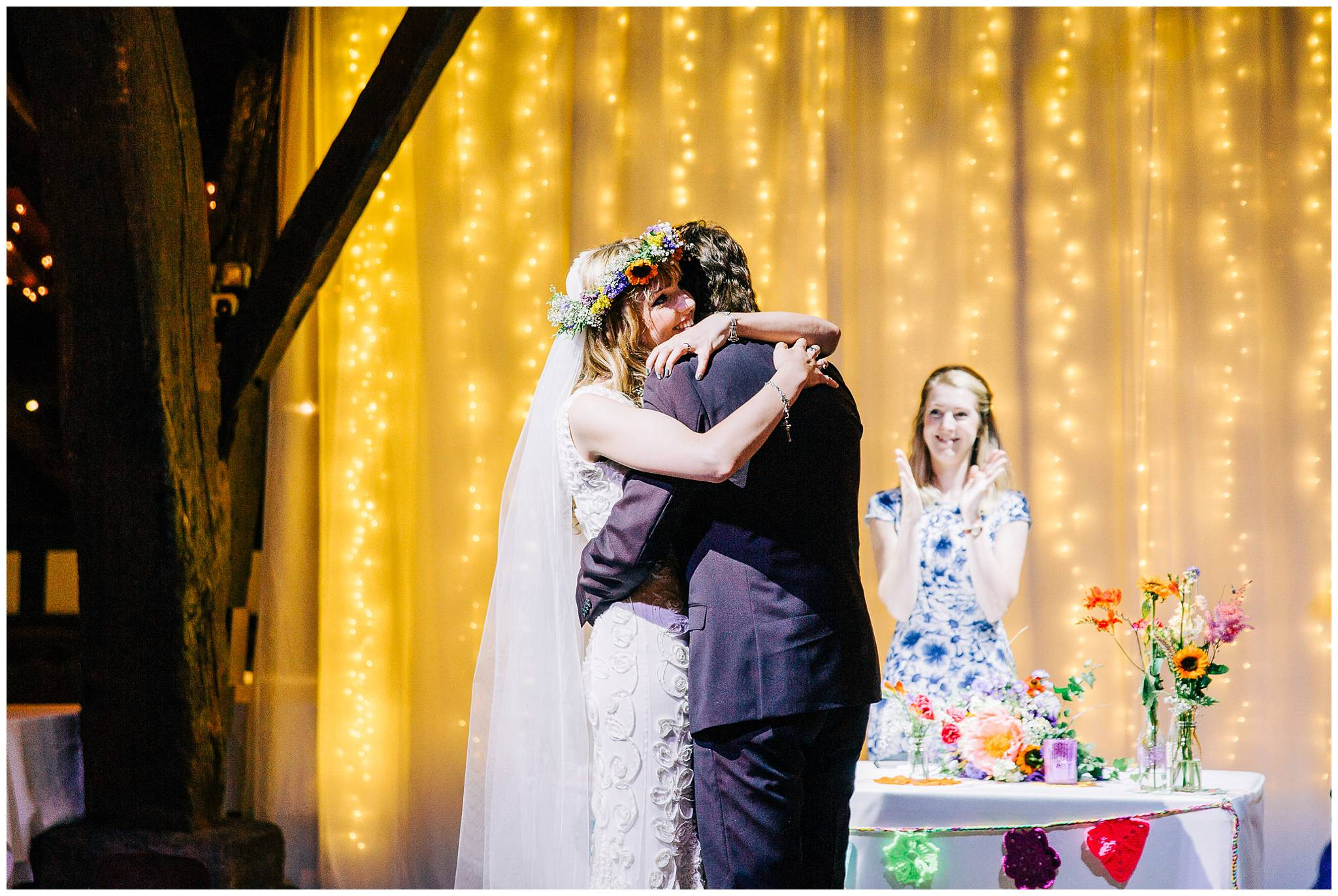bride and groom embrace after first kiss