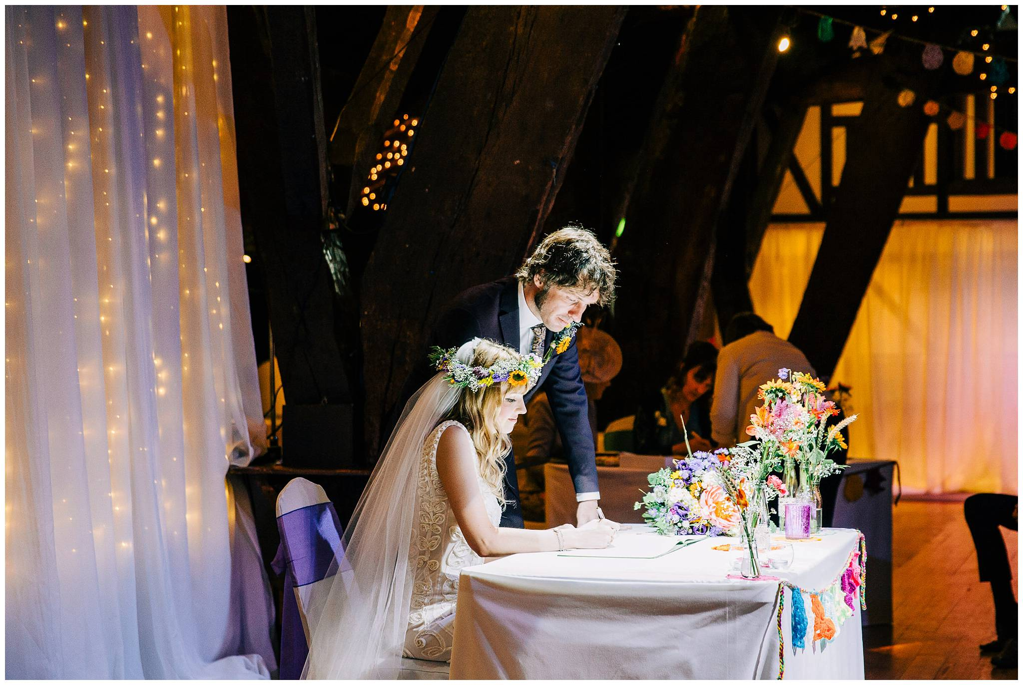 bride and groom naturally siging the marriage register