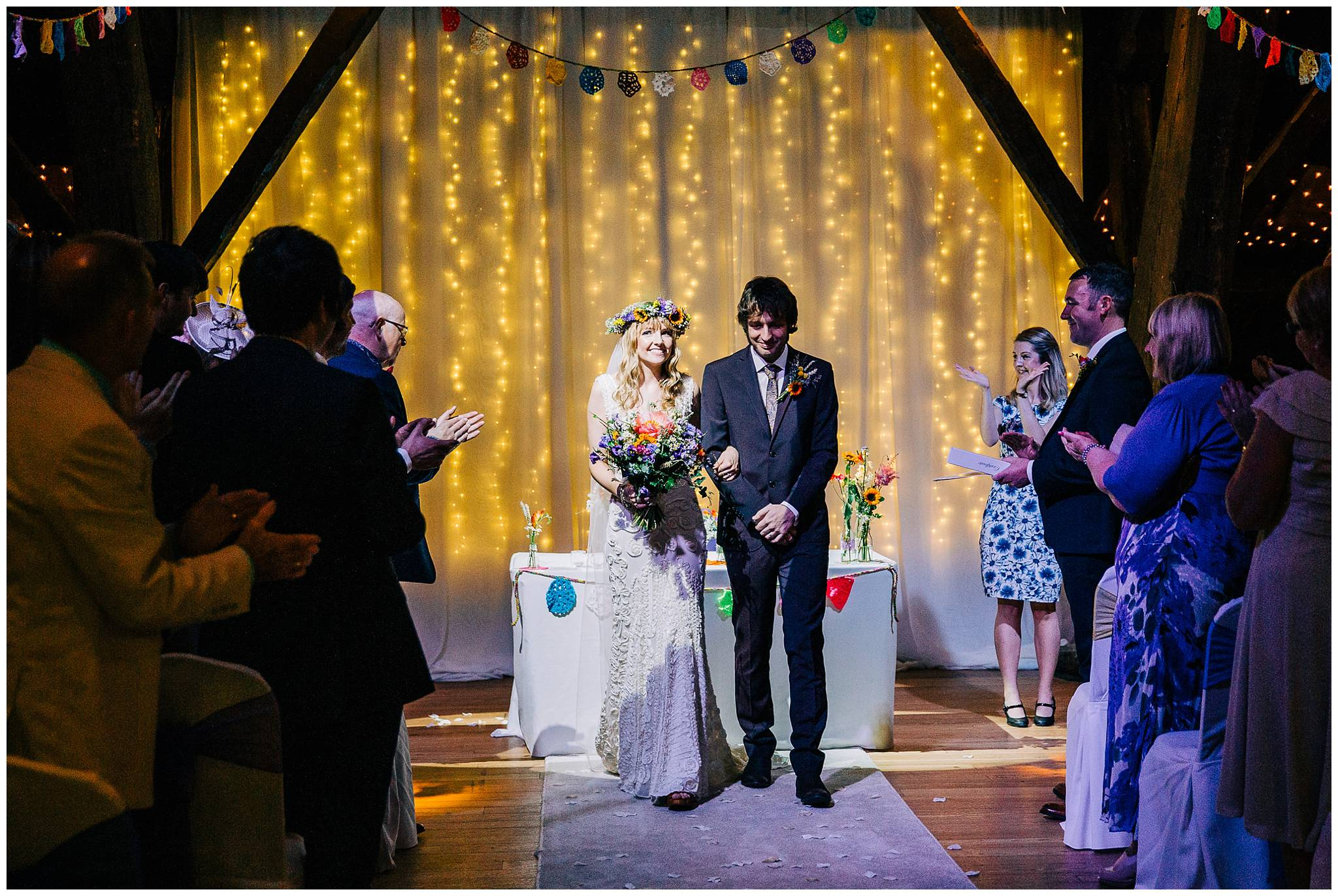 bride and groom extremely haoppy whilst walking back down aisle after ceremony