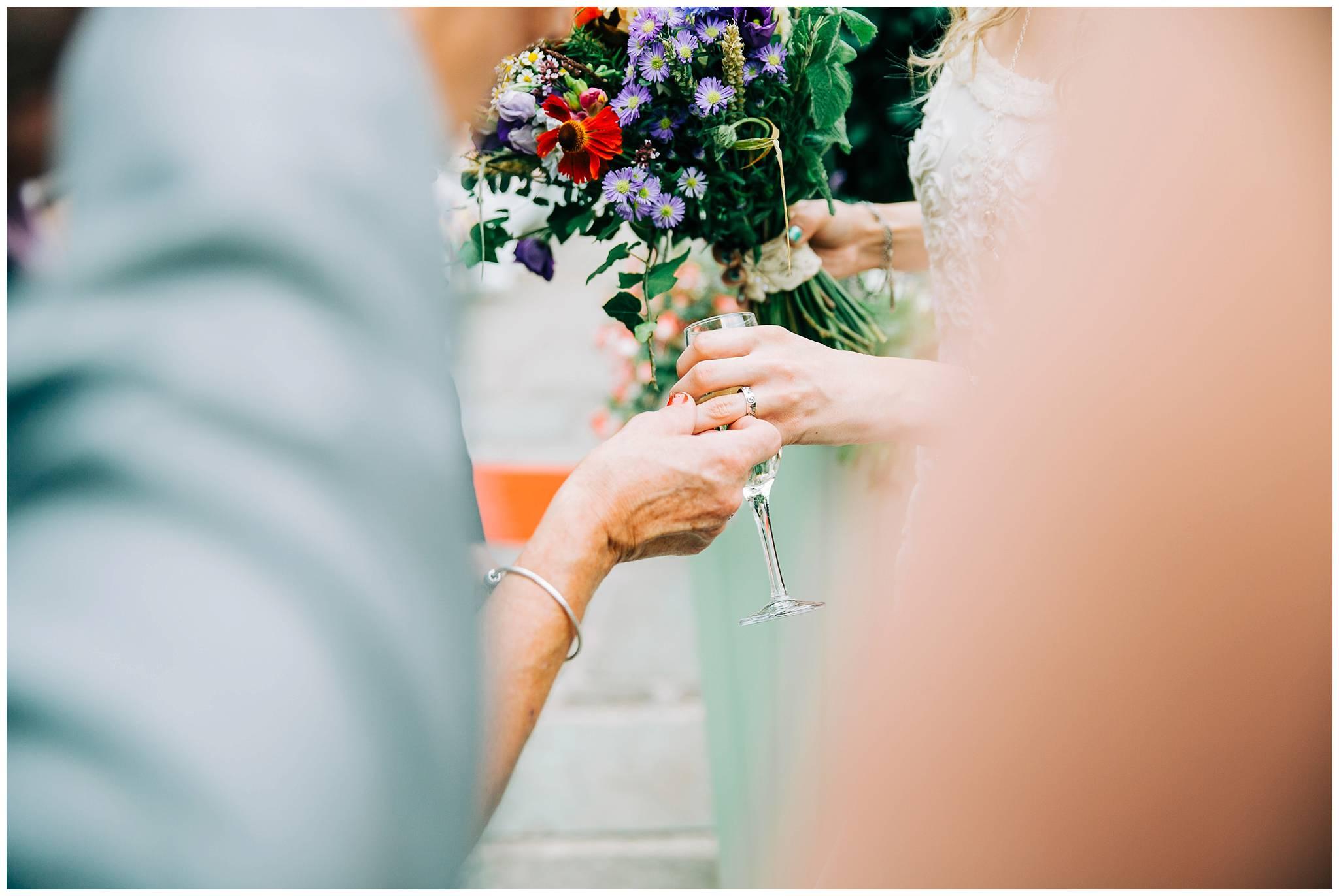 guest is looking at brides vintage wedding ring