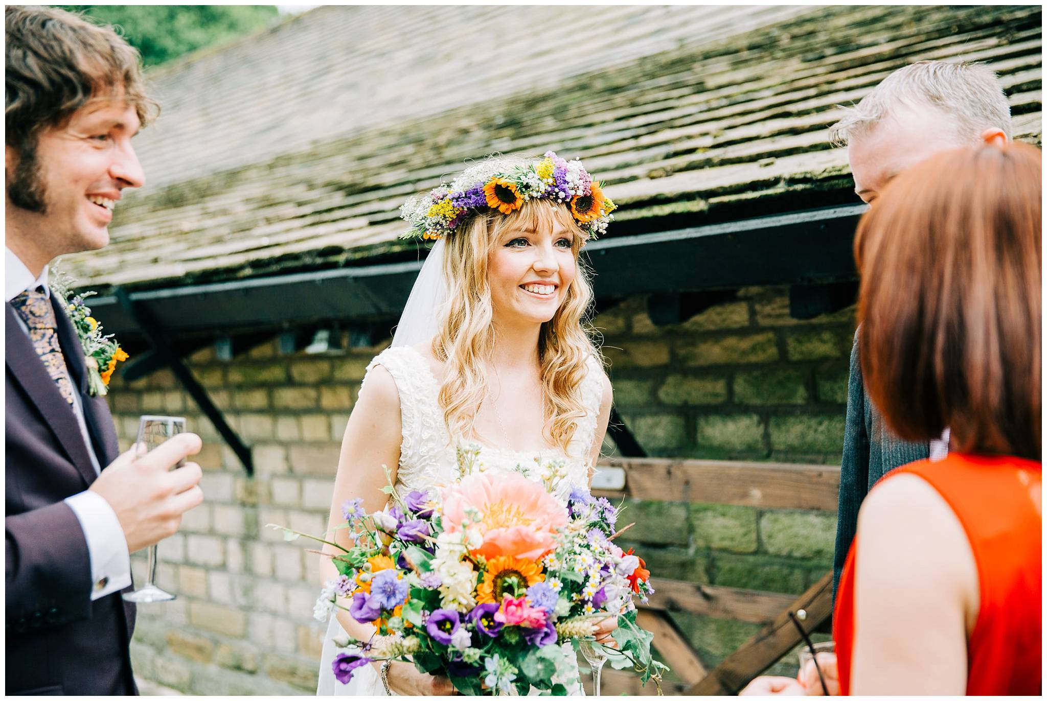 bride wearing dried floral crown smiling and talking to guests
