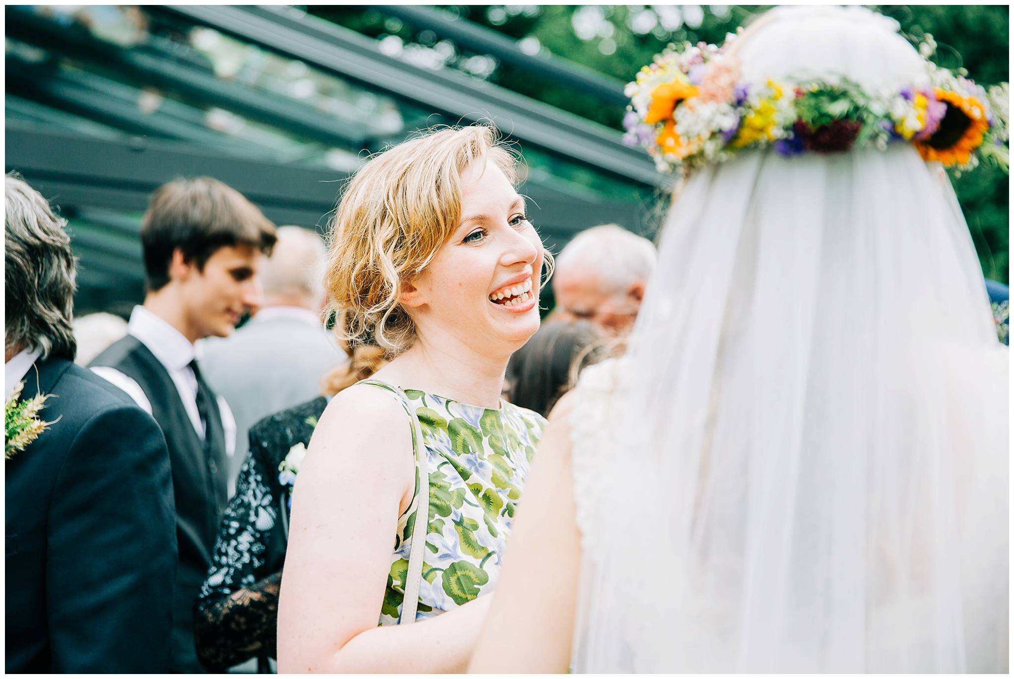guest smiling happily with bride