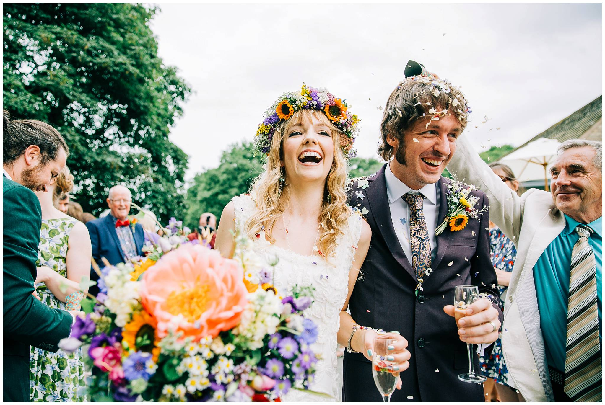 bride and groom overjoyed after confetti line