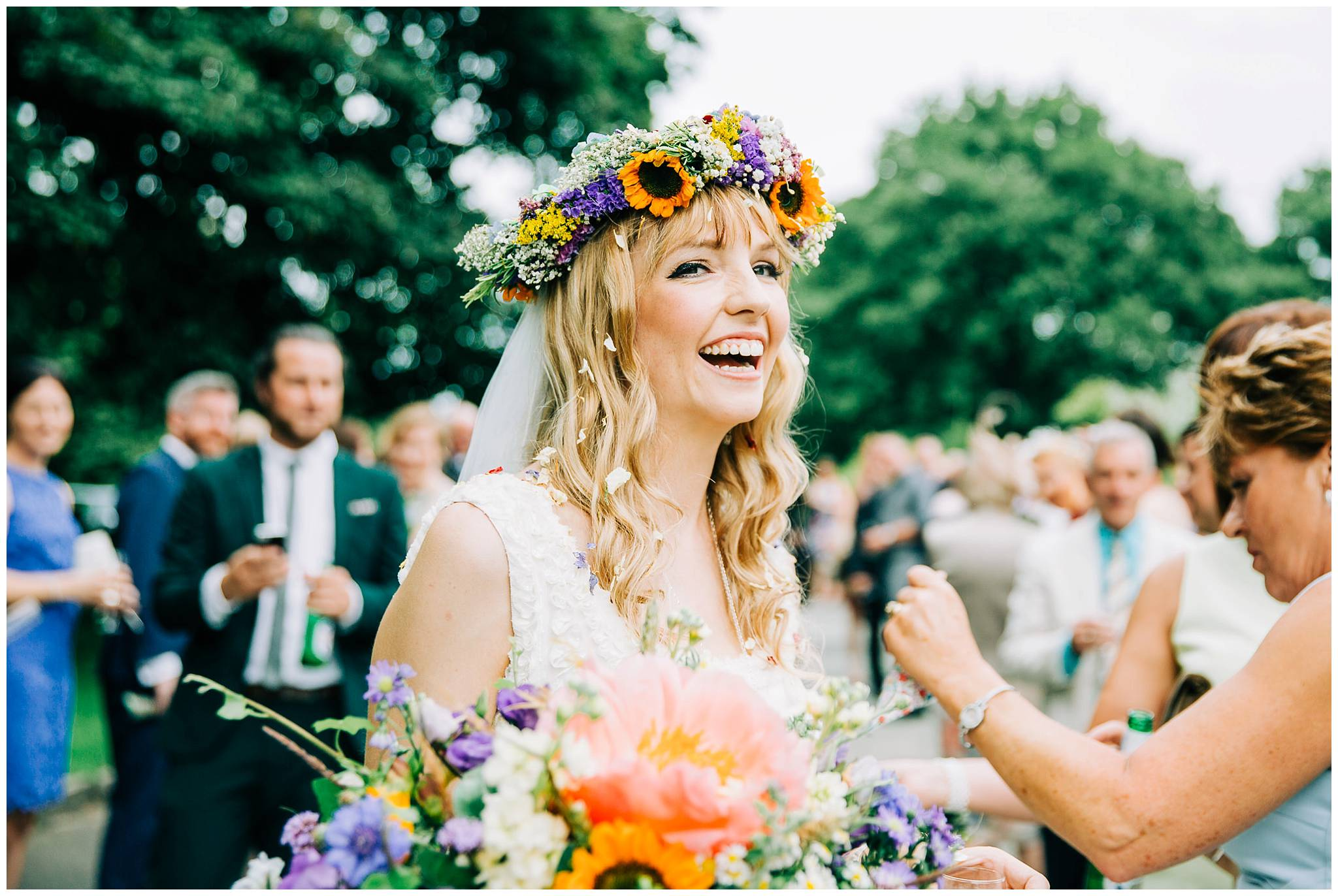bride with beautiful natural smile wearing wild floral crown