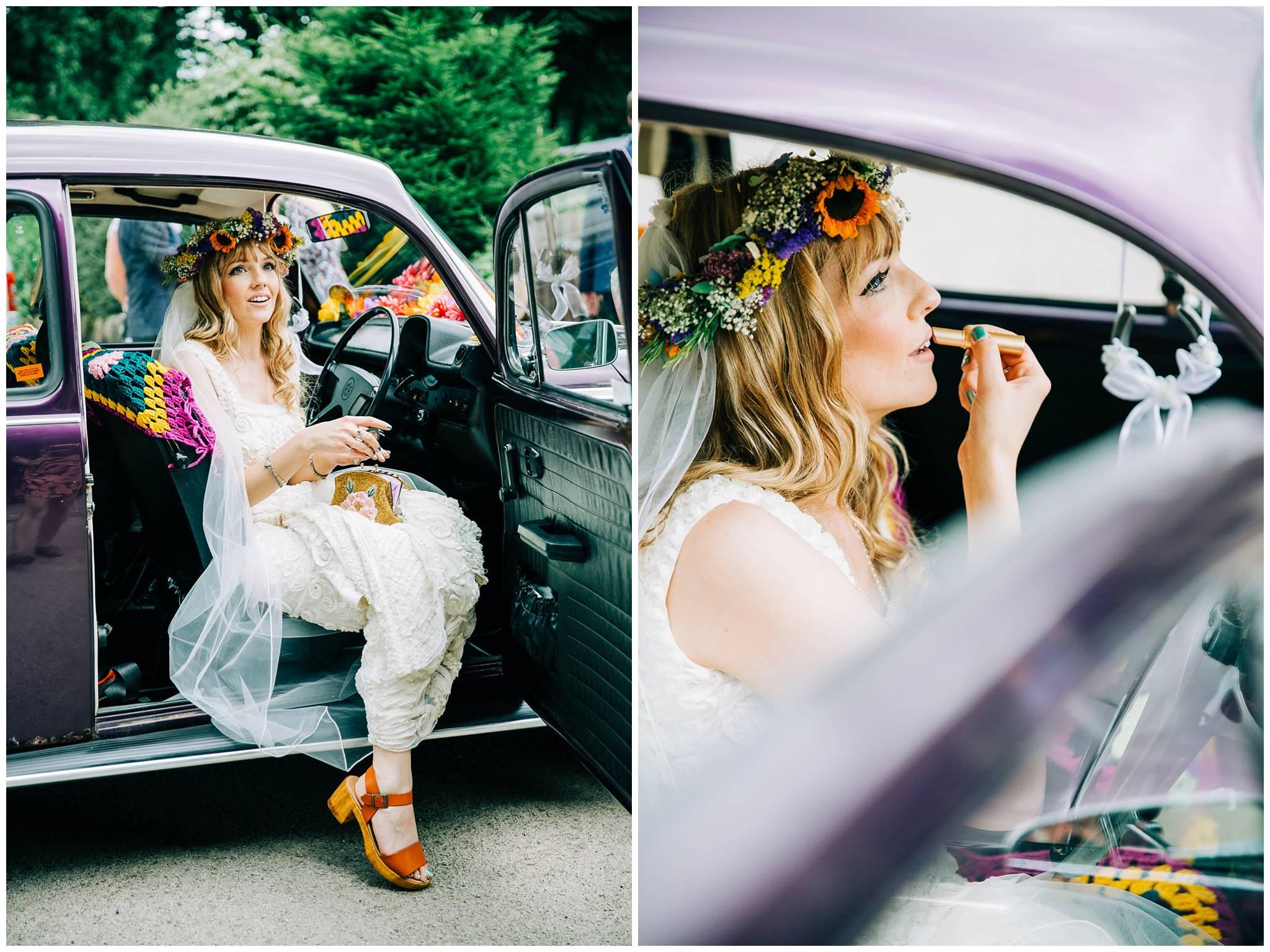 bride sat in front seat of VW beetle applying lipstick