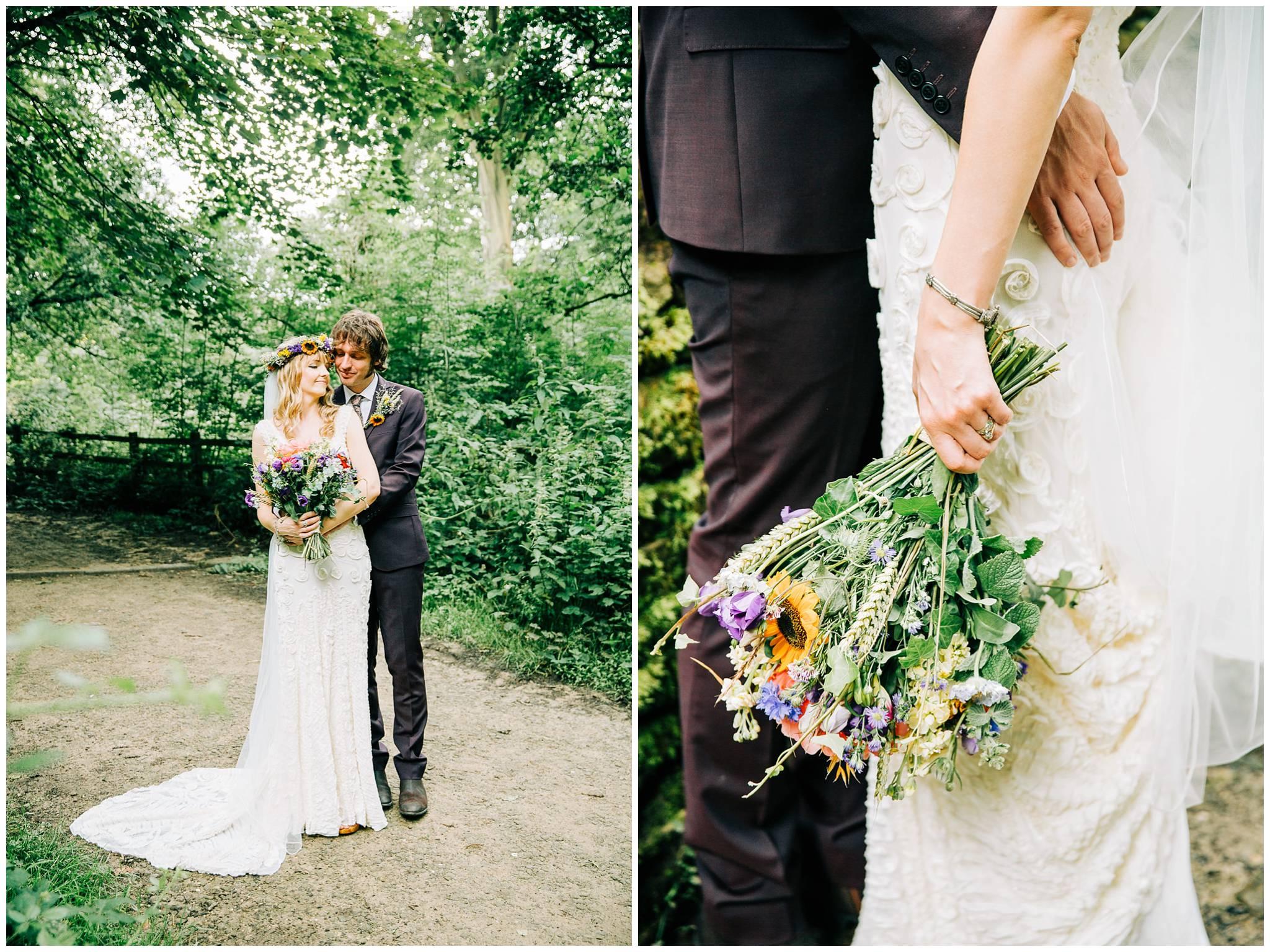 bride and groom cuddling in woodland setting