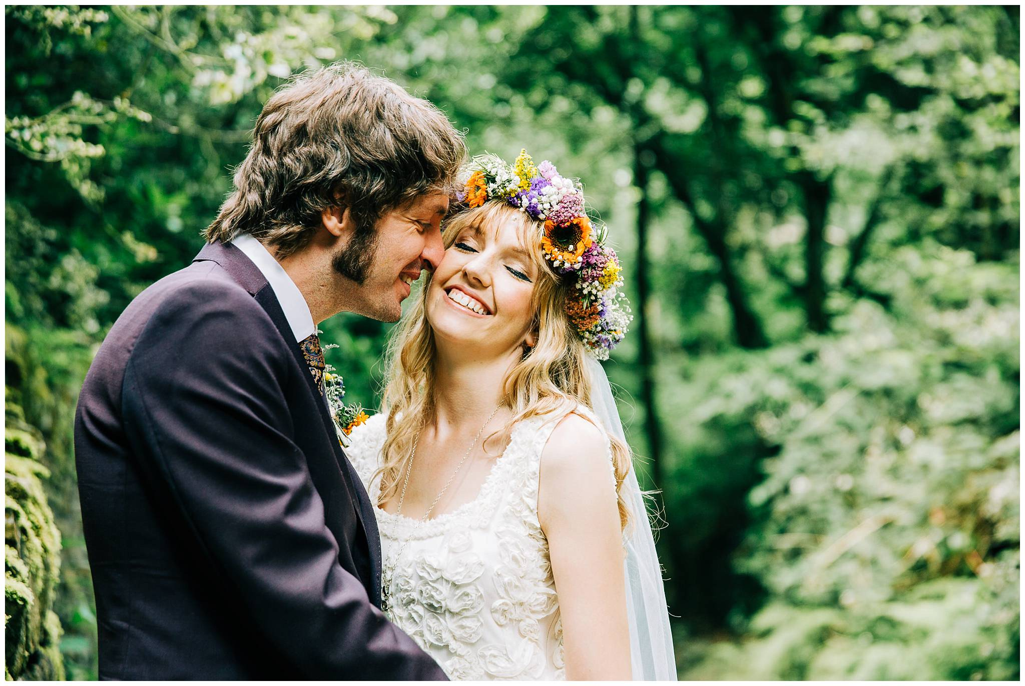 groom with his nose on brides cheek and bride smiling happily