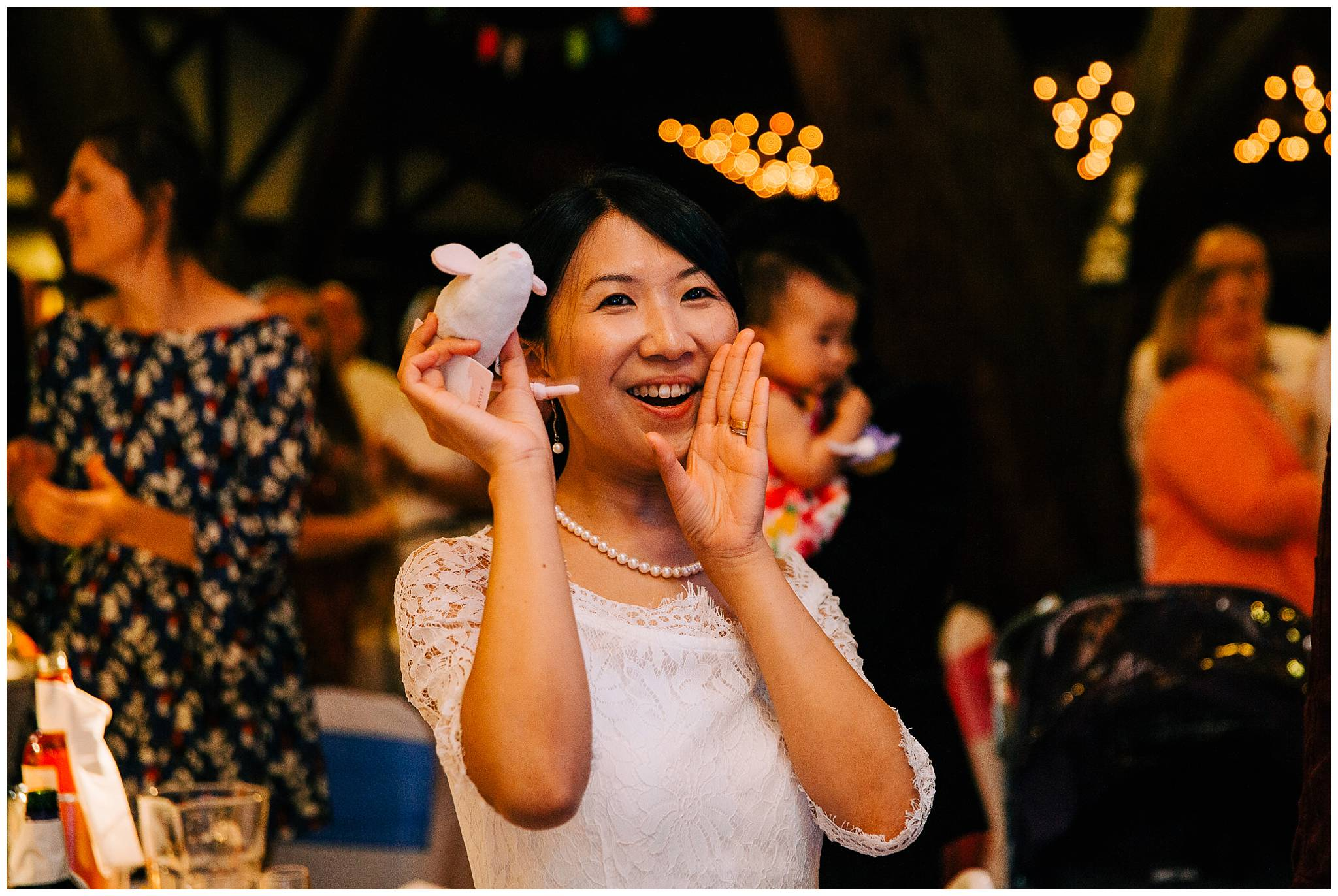 woman cheering holing a stuff toy mouse