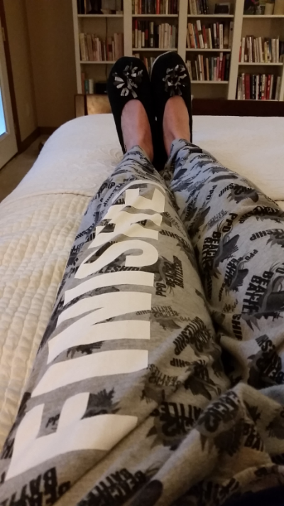 Wearing my Florida Finisher's medal, my B2B finisher's pants and eating a snack in bed.