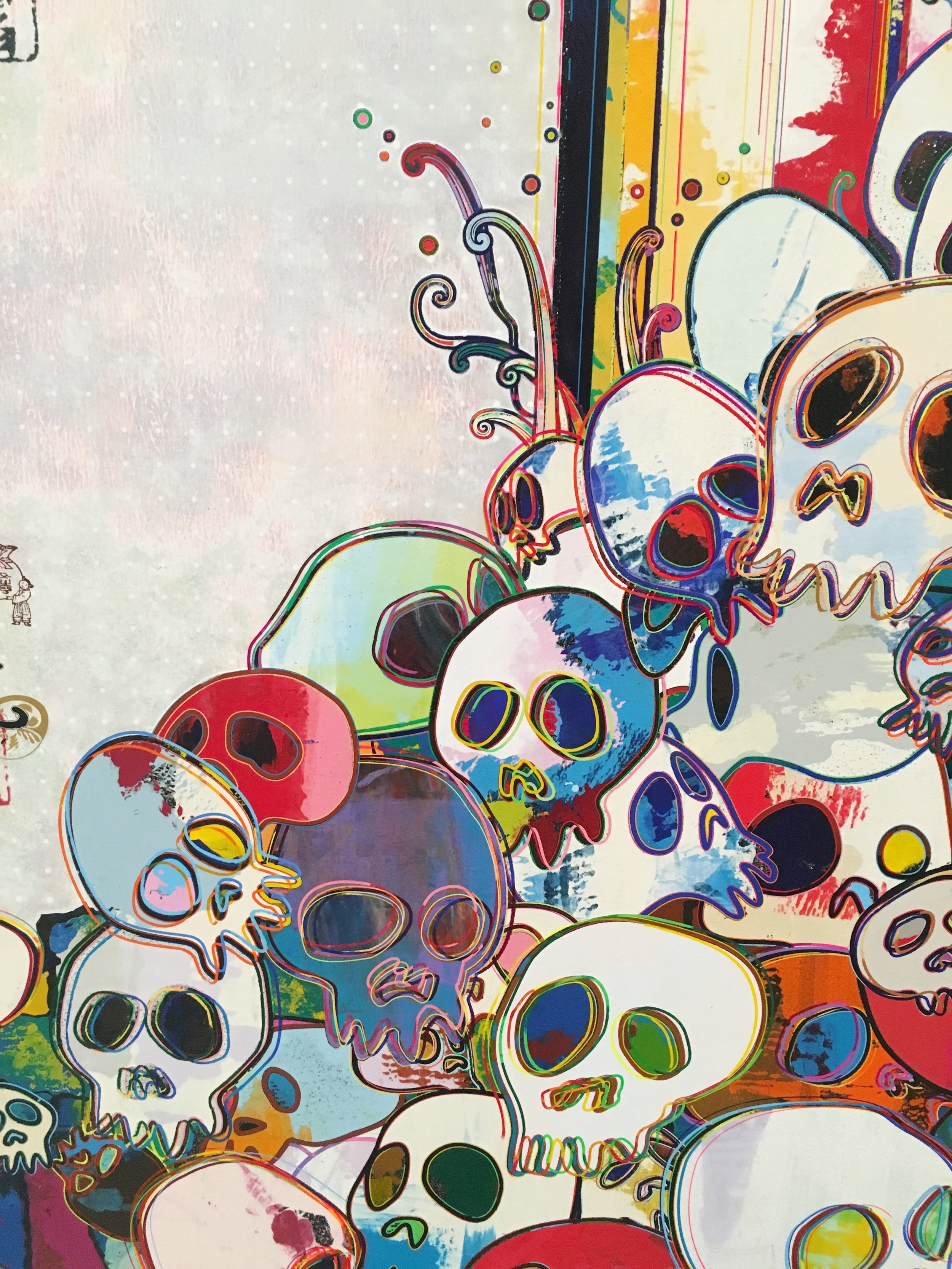 A closeup of Takashi Murakami's piece, Of Chinese Lions, Peonies, Skulls, and Fountains.