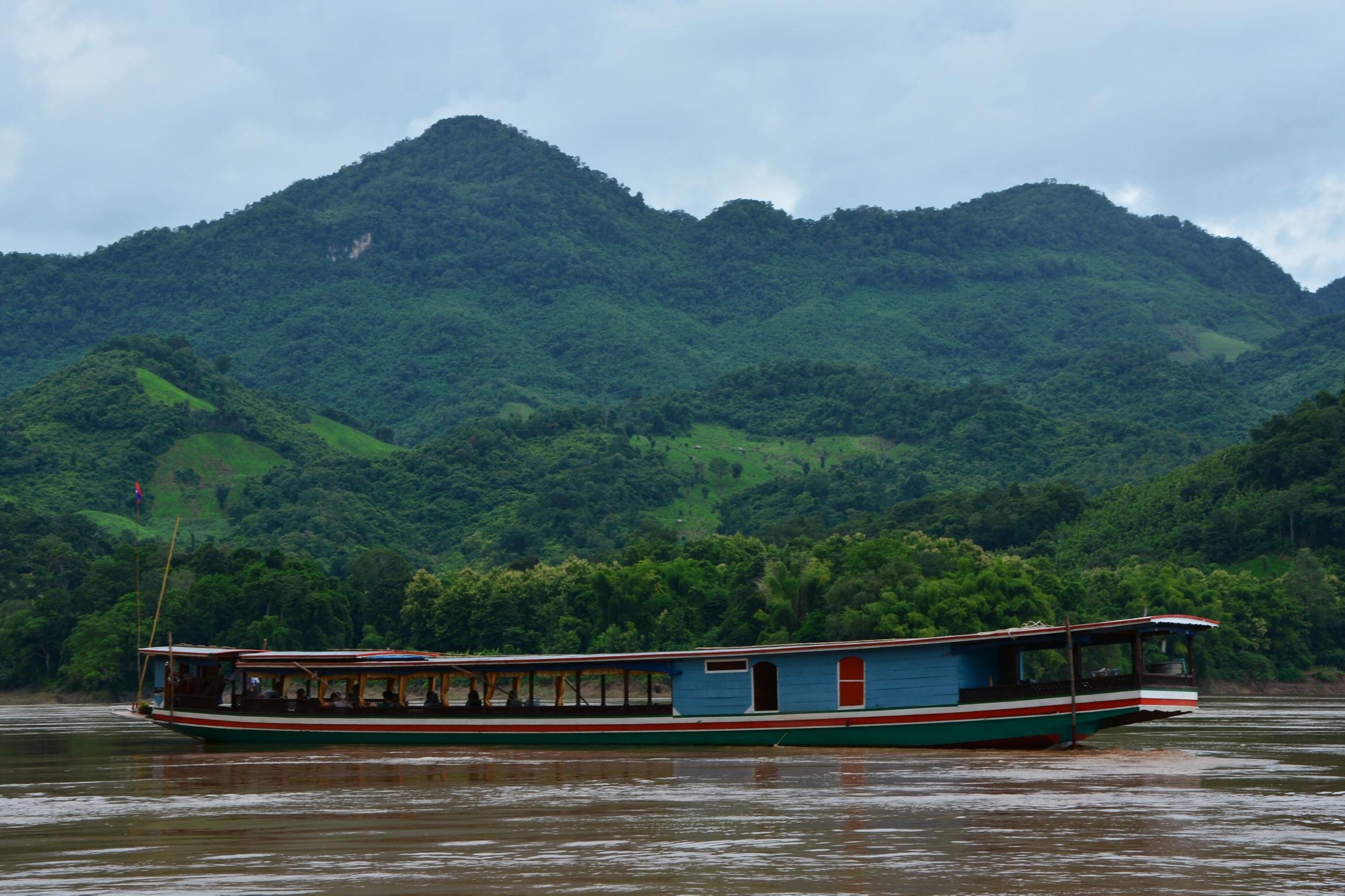 Longboating on the Mekong River.