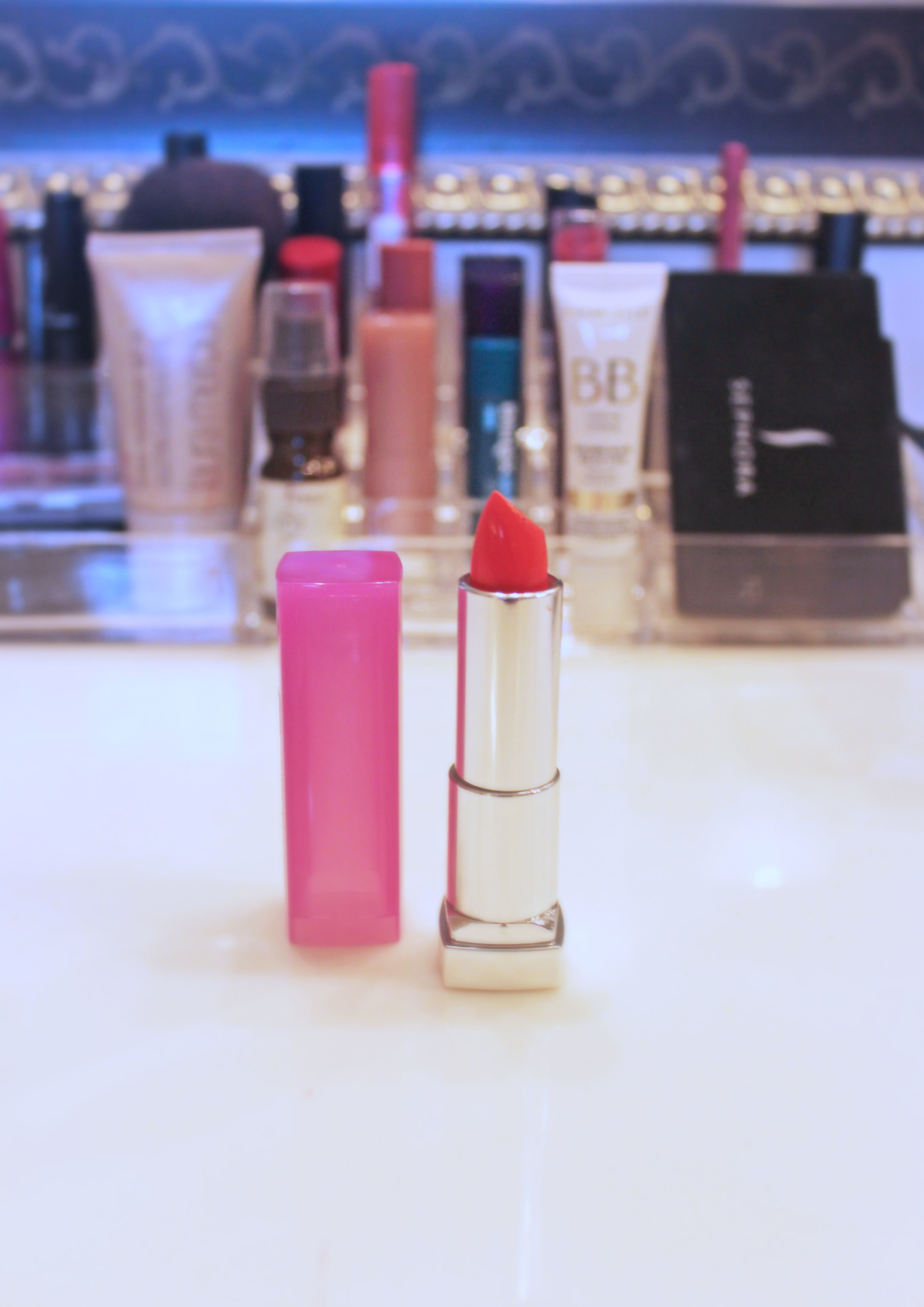 """best summer coral:   Maybelline Color Sensational Rebel Bloom in """"Coral Burst""""    It took a really long time for me to get on board with coral lipstick; I used to never feel very comfortable in it. Now it's one of my favorite lipsticks for summer, and I think this Maybelline has just the right amount of punch to it. I also love how smoothly all the Color Sensational lipsticks seem to go on; no liner needed which is nice."""