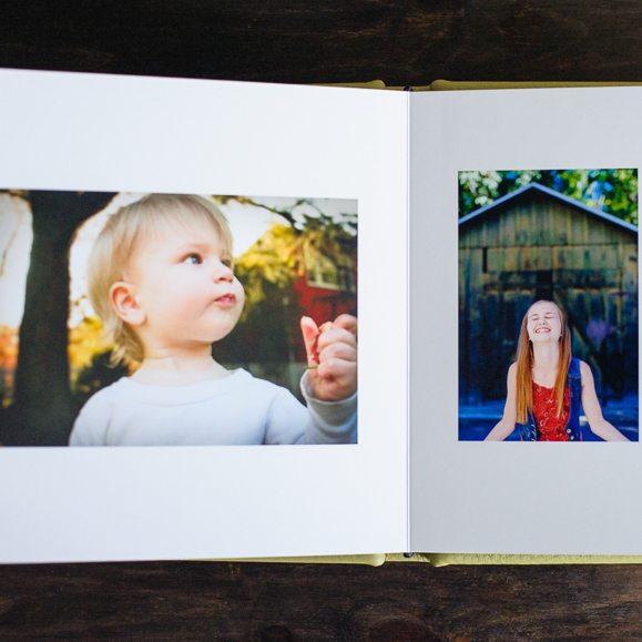 """""""I have received this family album made by you at home yesterday. It is truly beautiful, the colors and paper quality are excellent and perfect. it is one of the best treasures that I own in my life, Thank you so much."""" --Rosa C."""