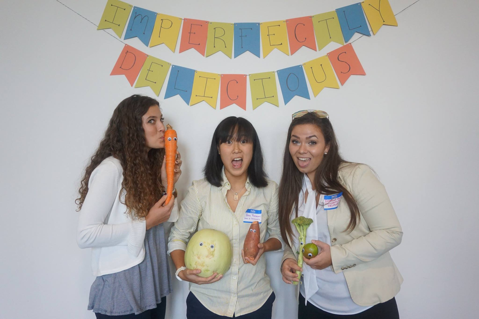 E-board members Macy Oteri, Jaime Renman, and Izzy Aswad pose with produce that is rejected due to its imperfections at the NFRD conference.