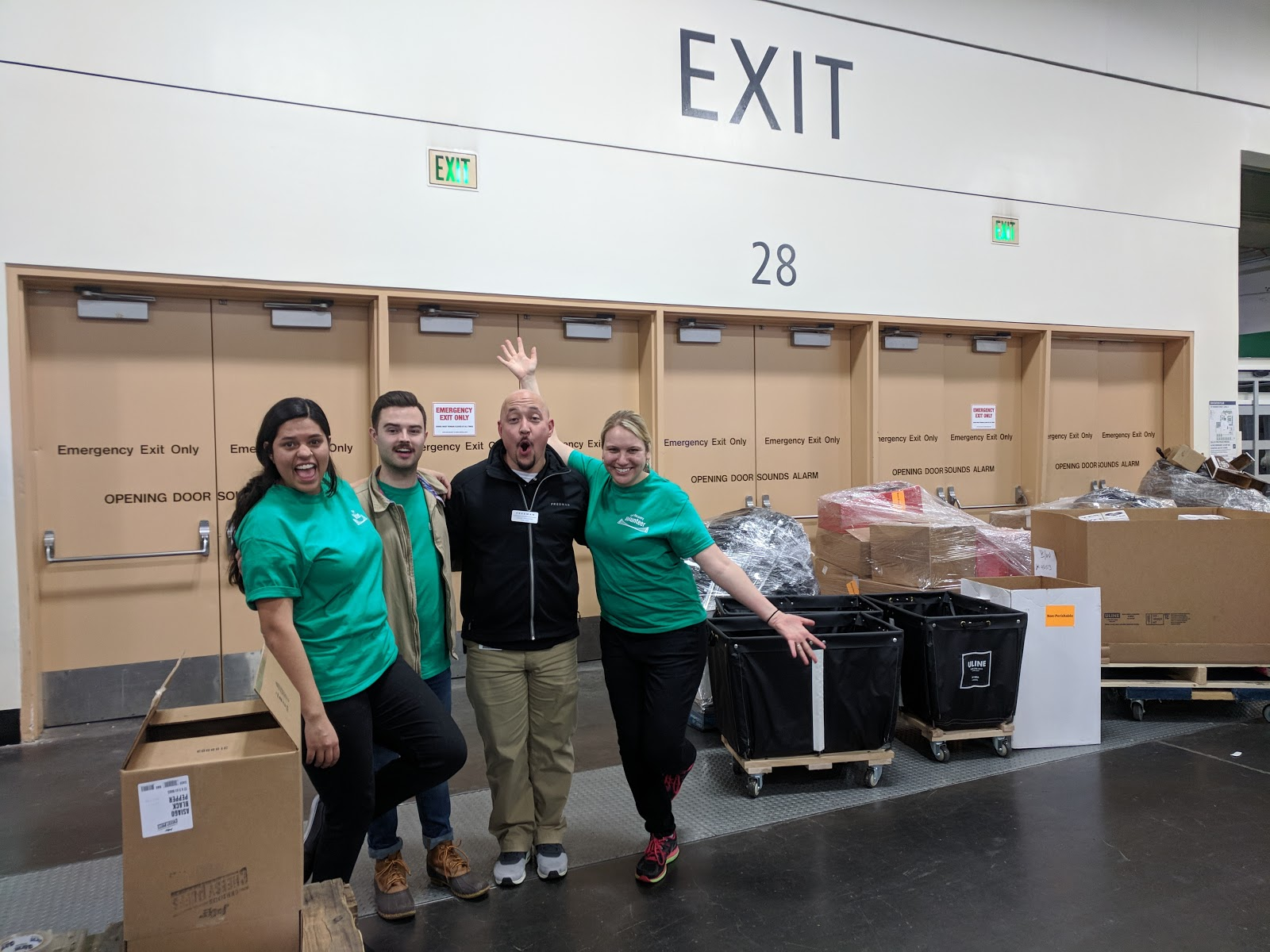FRN National's 2018 Winter Fancy Food Show Recovery Organizers (Paloma Sisneros-Lobato, Michael Boyd, and Annie Lobel, in green shirts) with the Director of Freight Operations at The Freeman Company (Louis Travieso, center) ecstatic to see the amount of incredible food being redirected from the landfill