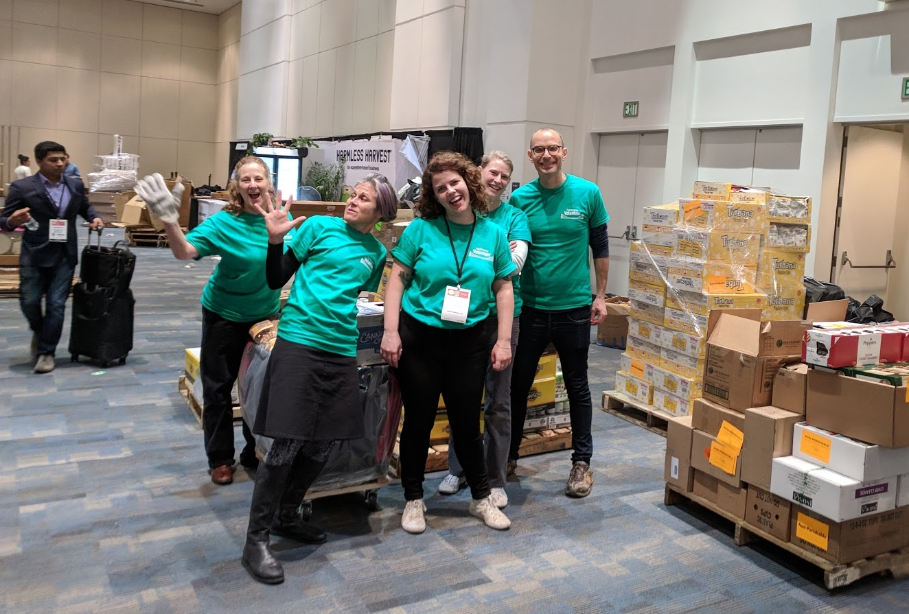 FRN Program Manager Hannah Cather and enthusiastic volunteers recovering from the show floor in the Moscone Center Esplanade