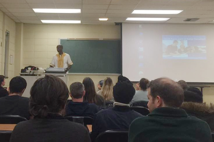 Chef Kabui presenting to the students at UNCG