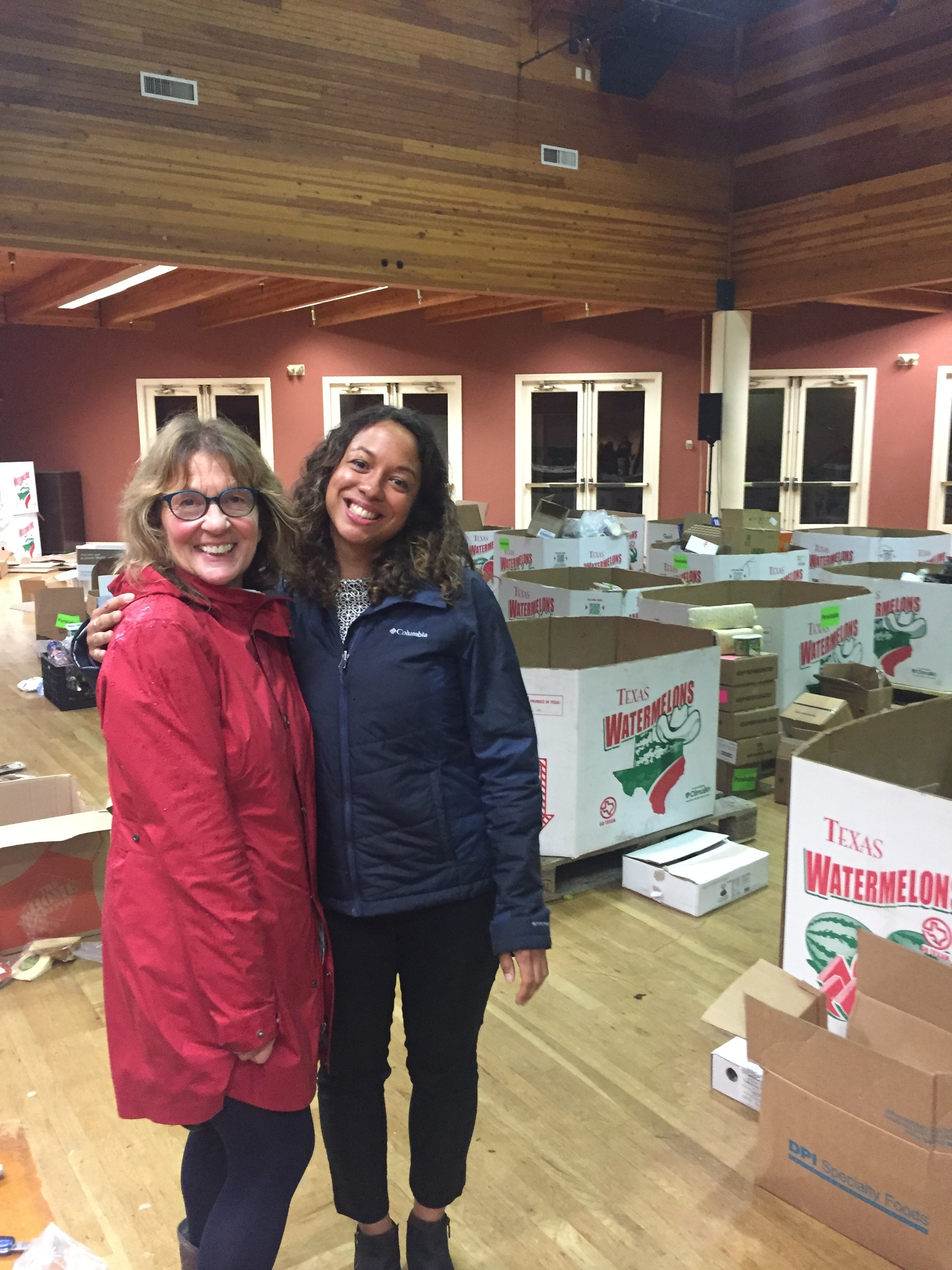 Stephanie Muller, Director of Development at Delancey Street Foundation (left) with Regina Anderson, Executive Director at Food Recovery Network (right) are all smiles as recovered food is delivered and unpacked in the Delancey Street kitchen.