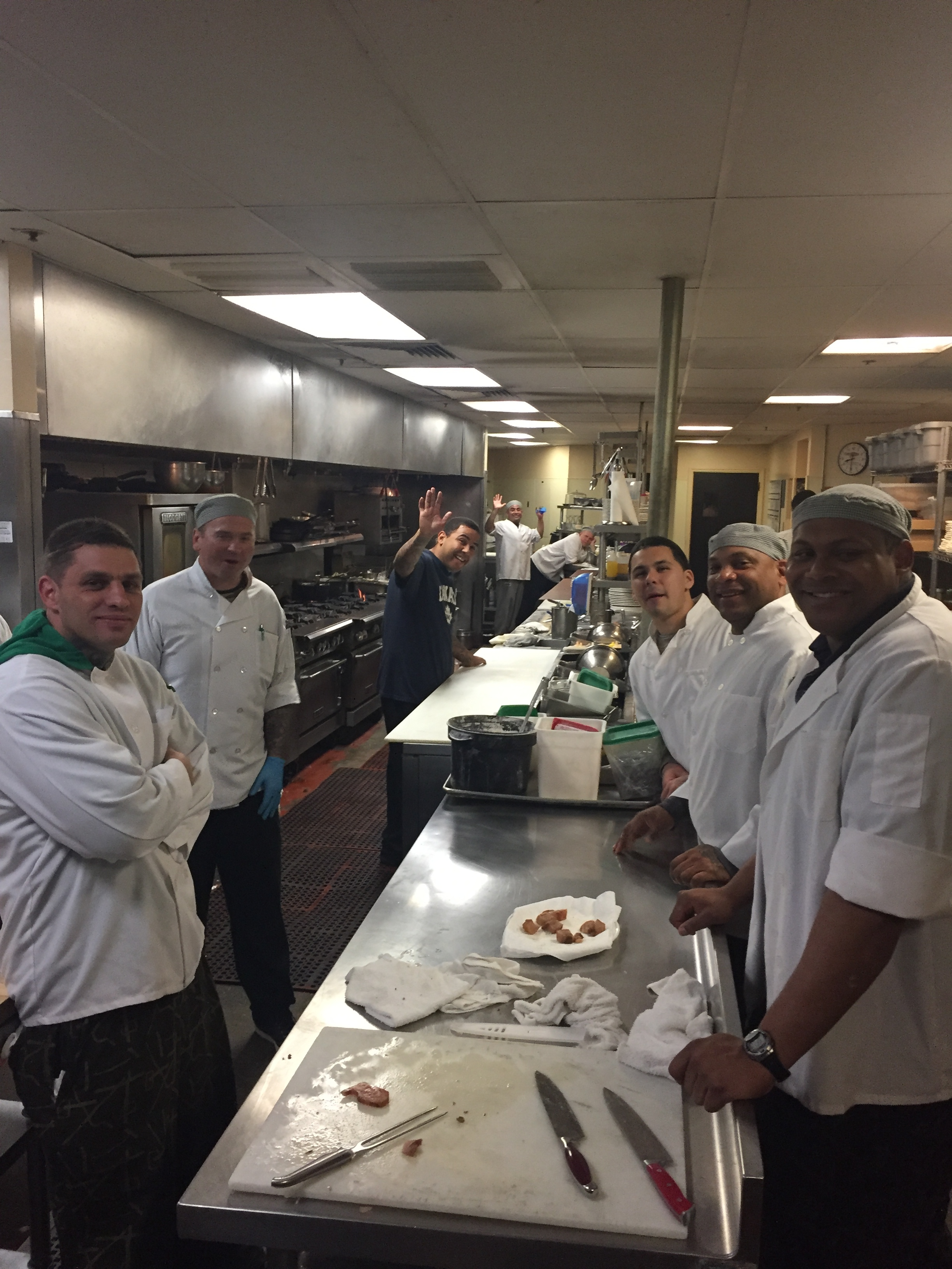 The Delancey Street Foundation's kitchen crew give thanks for the recovered food.