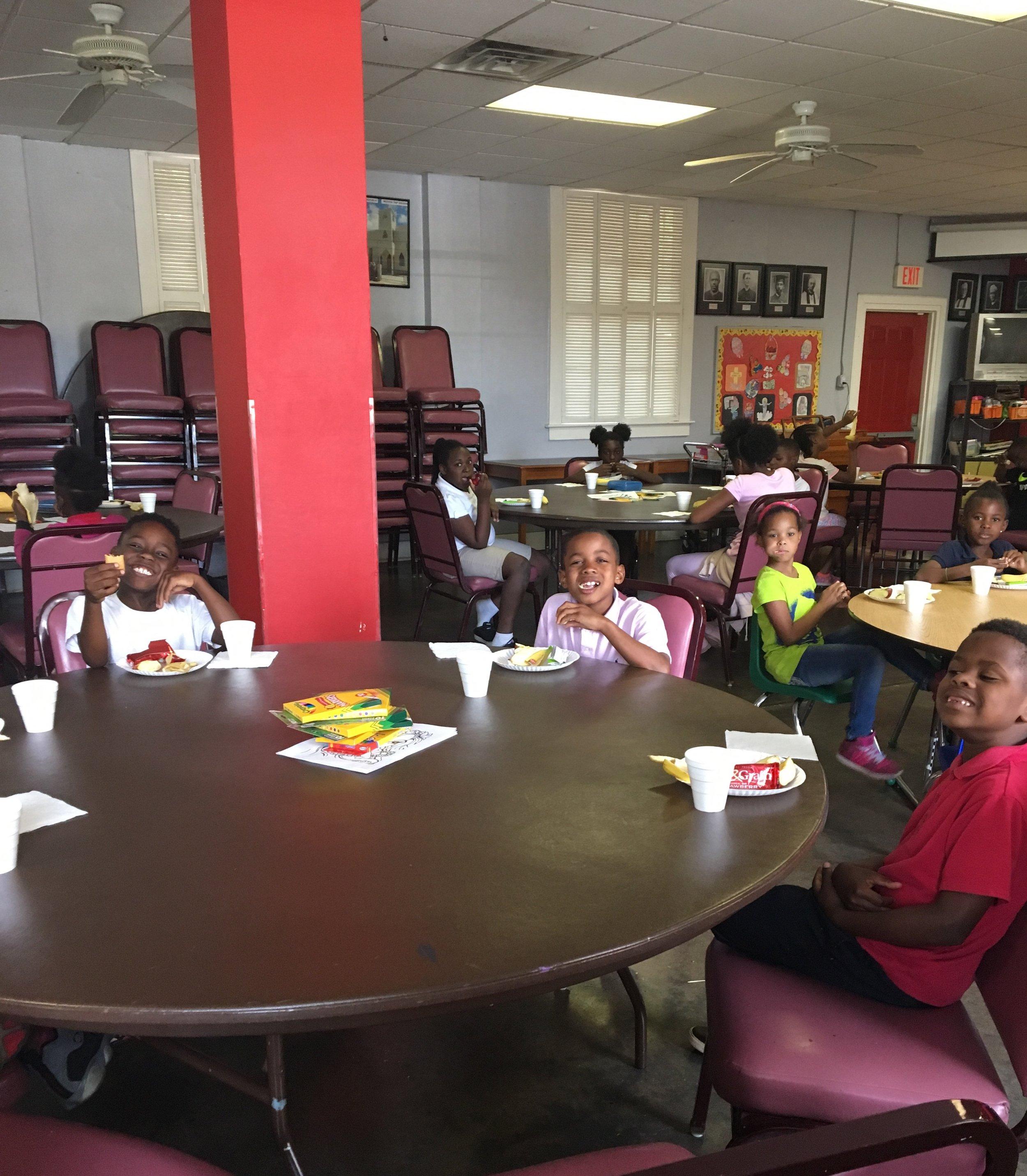 Children at Cornerstone Kids Inc. enjoying their meals.