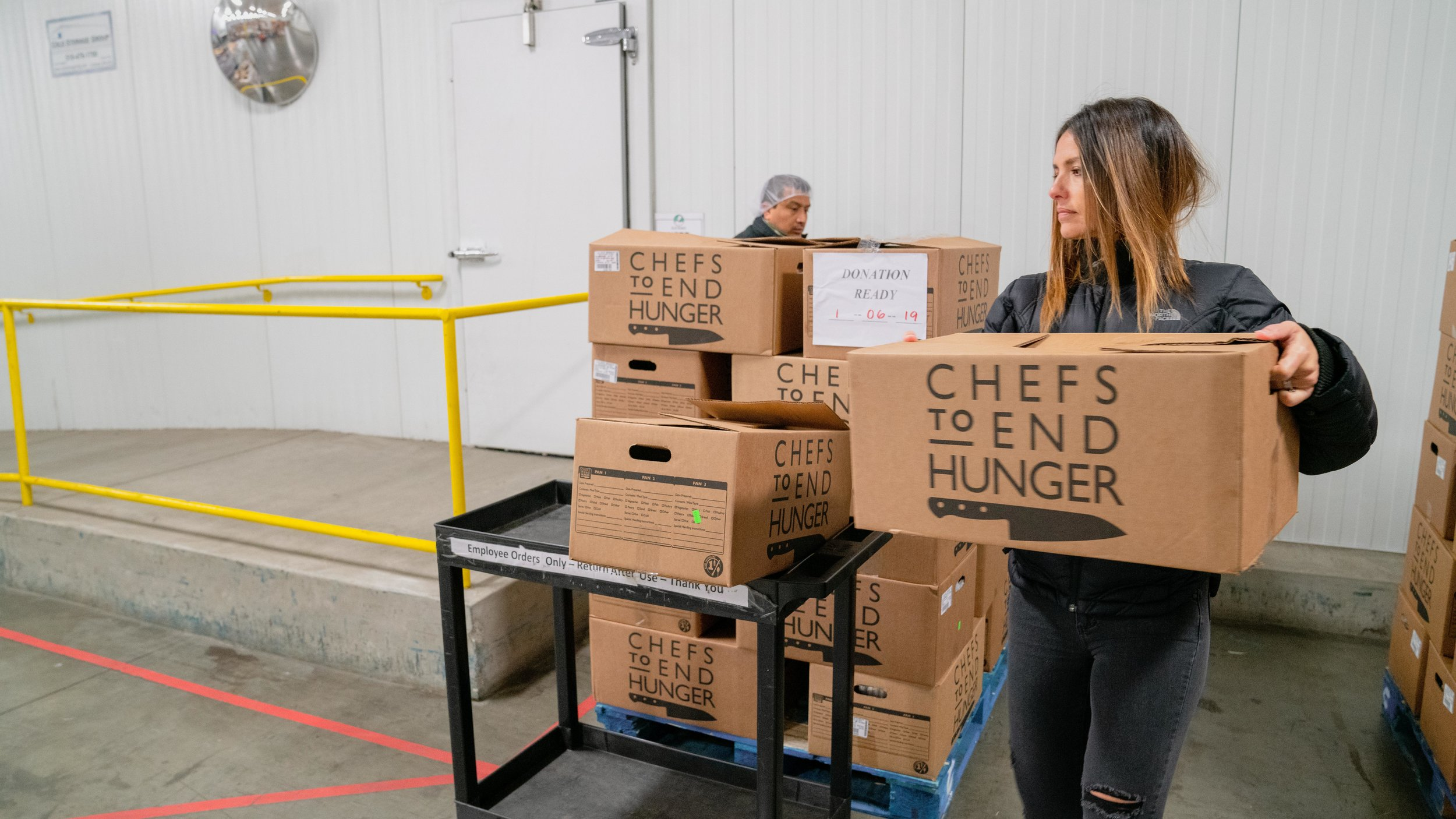 Folks at Chefs to End Hunger package and prepare the hunger kits to be shipped off to another hunger-fighting nonprofit.