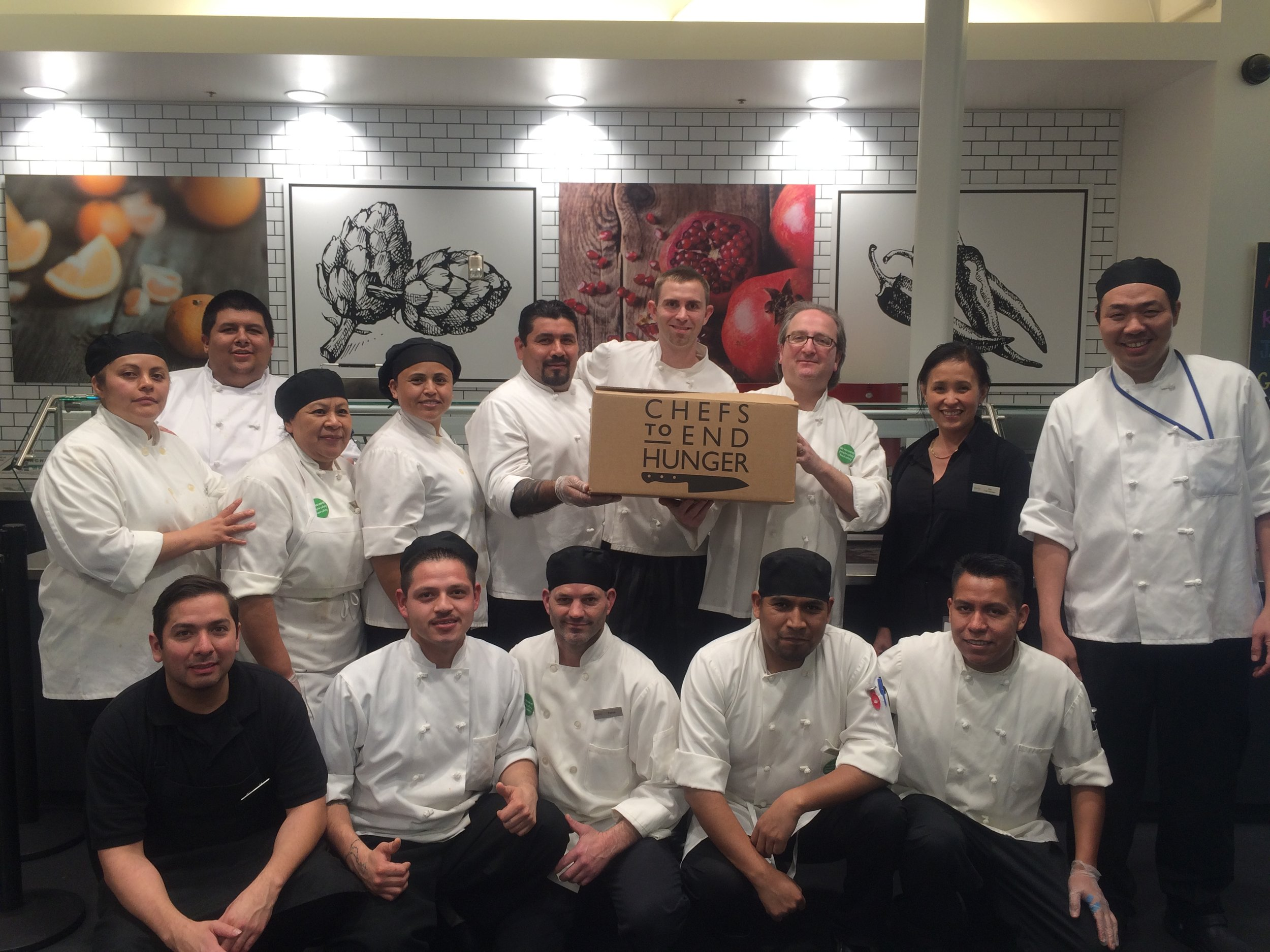 Chefs at Bon Appétit at SAP are showing their pride for Chefs to End Hunger by posing with a hunger kit.