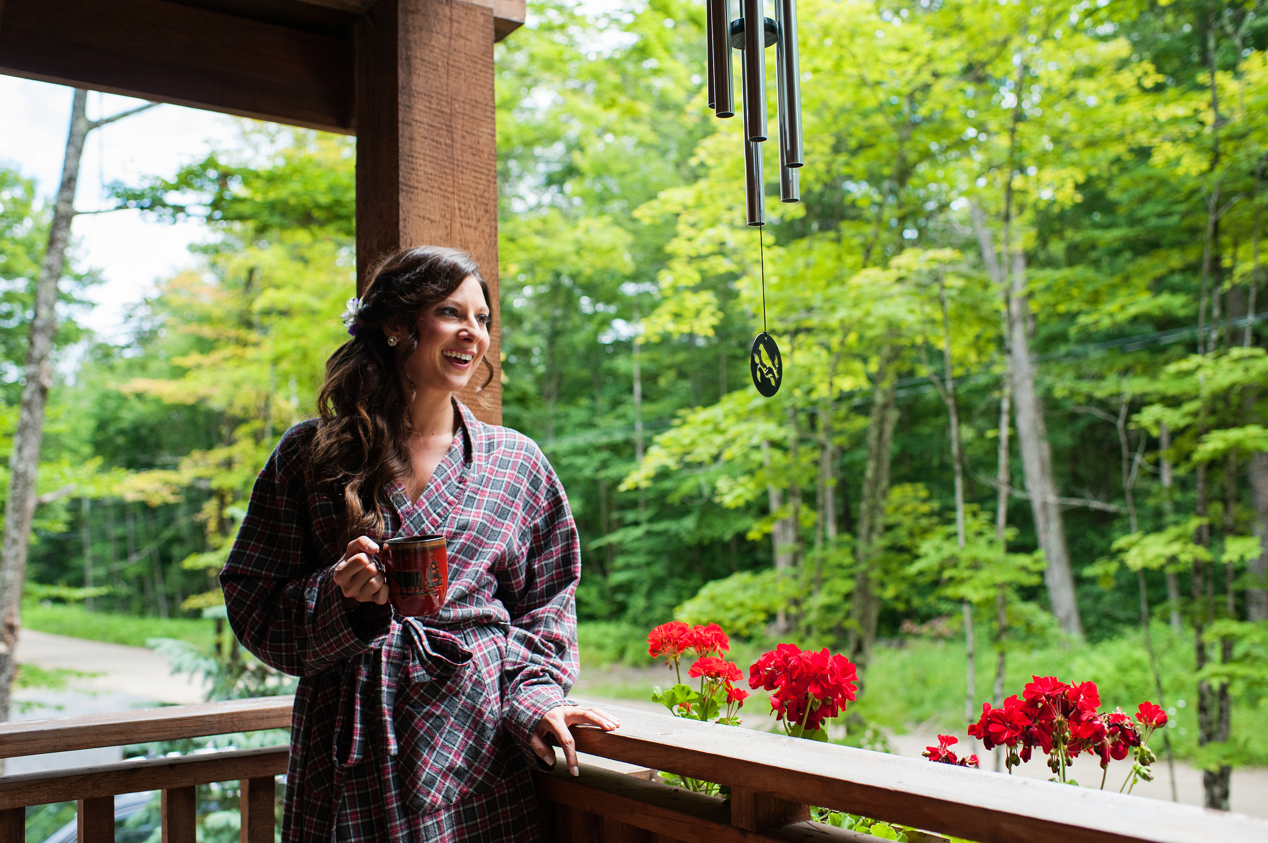 bride on cabin porch drinking coffee