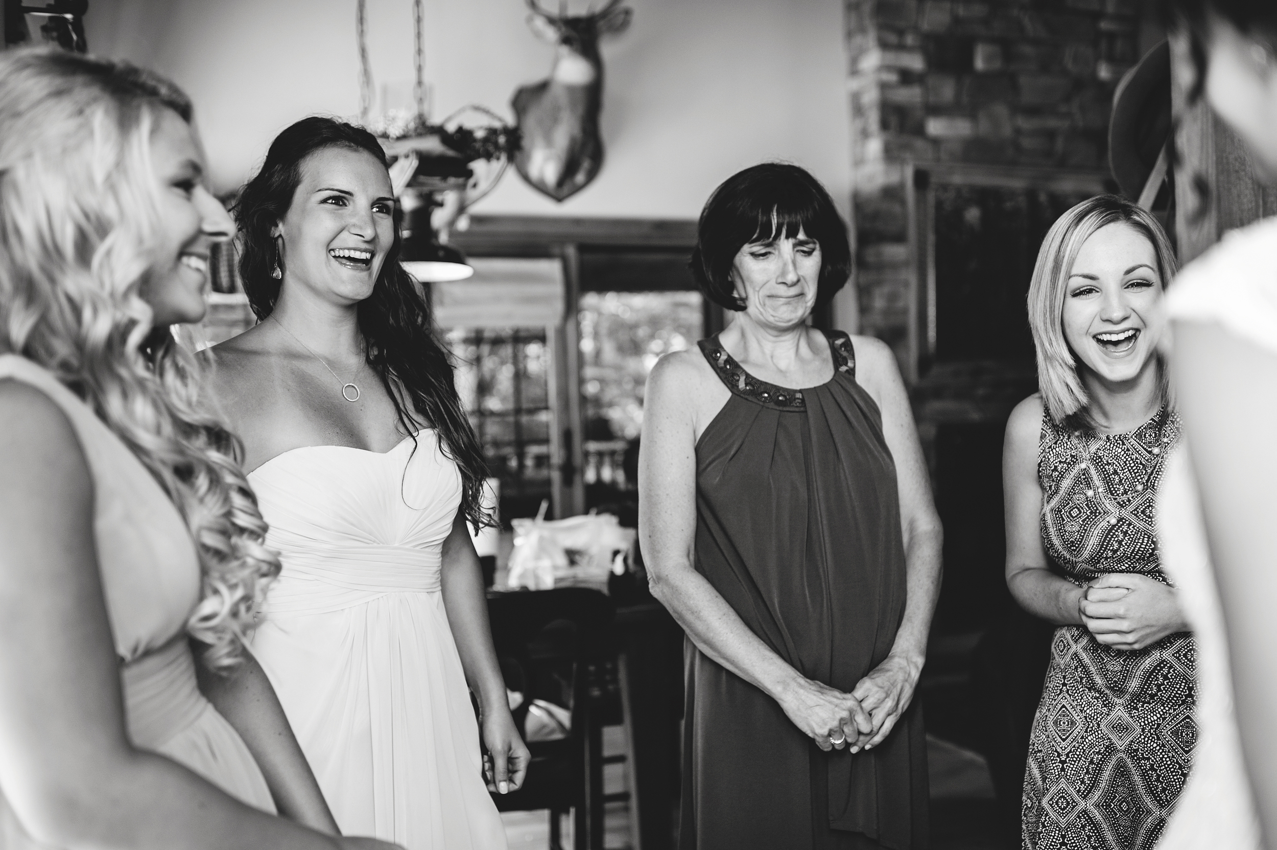 mother in-law expression with bride dress reveal