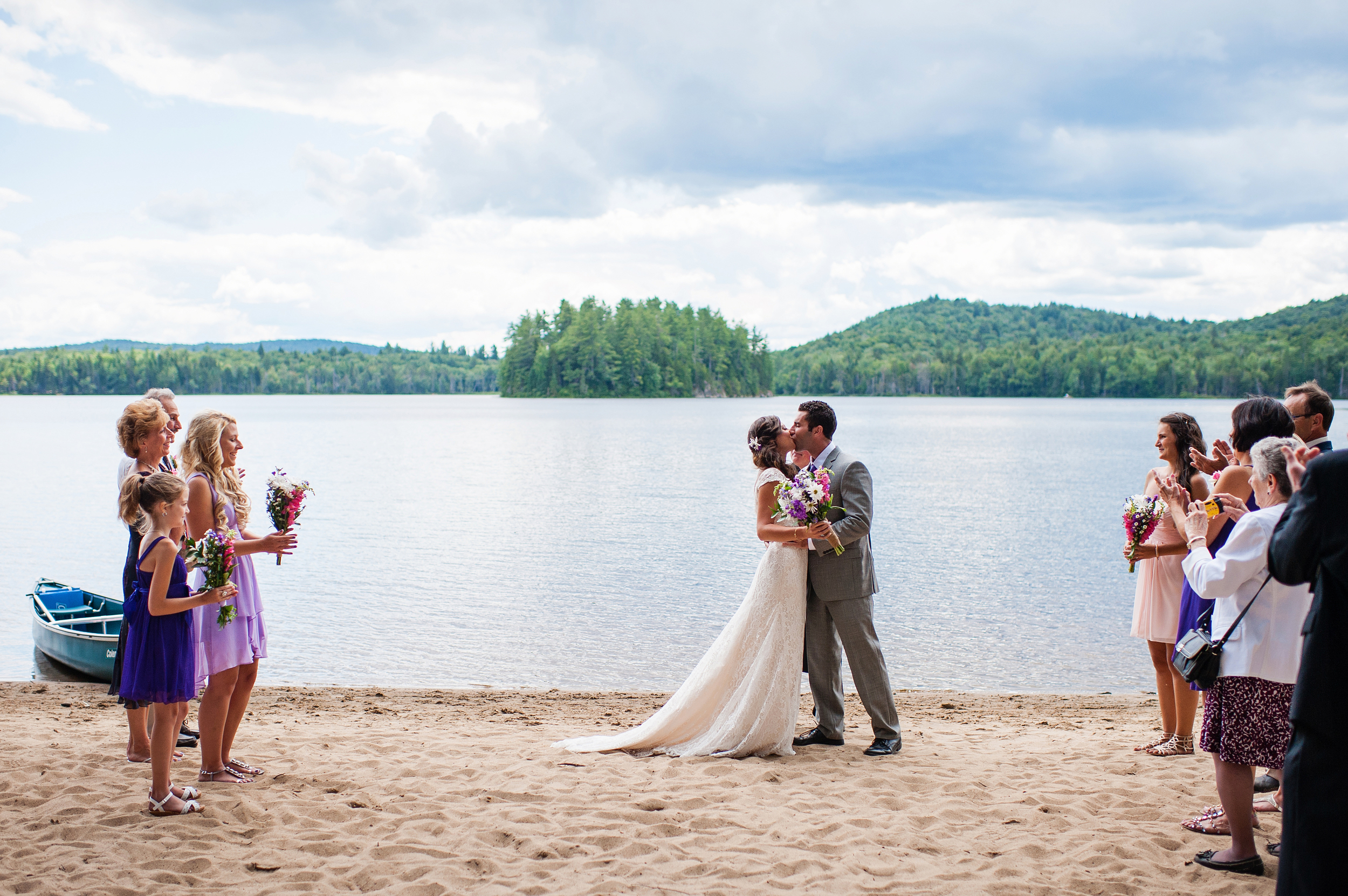 bride and groom first kiss adirondack wedding brown tract pond