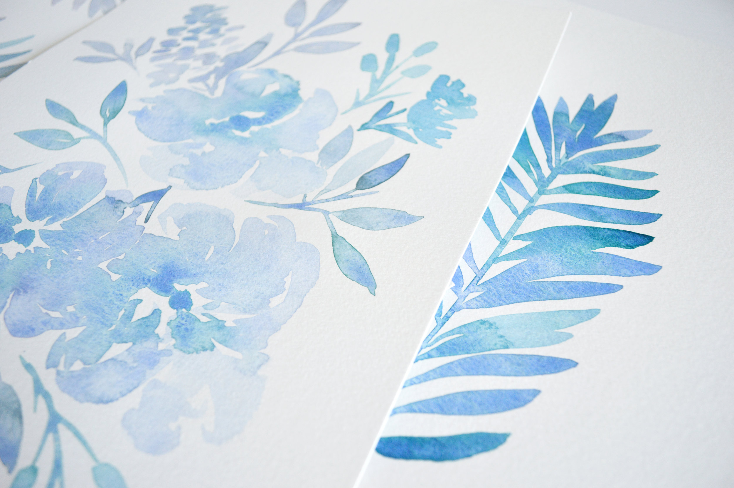 Blue watercolor florals and palms by Kristen Laczi