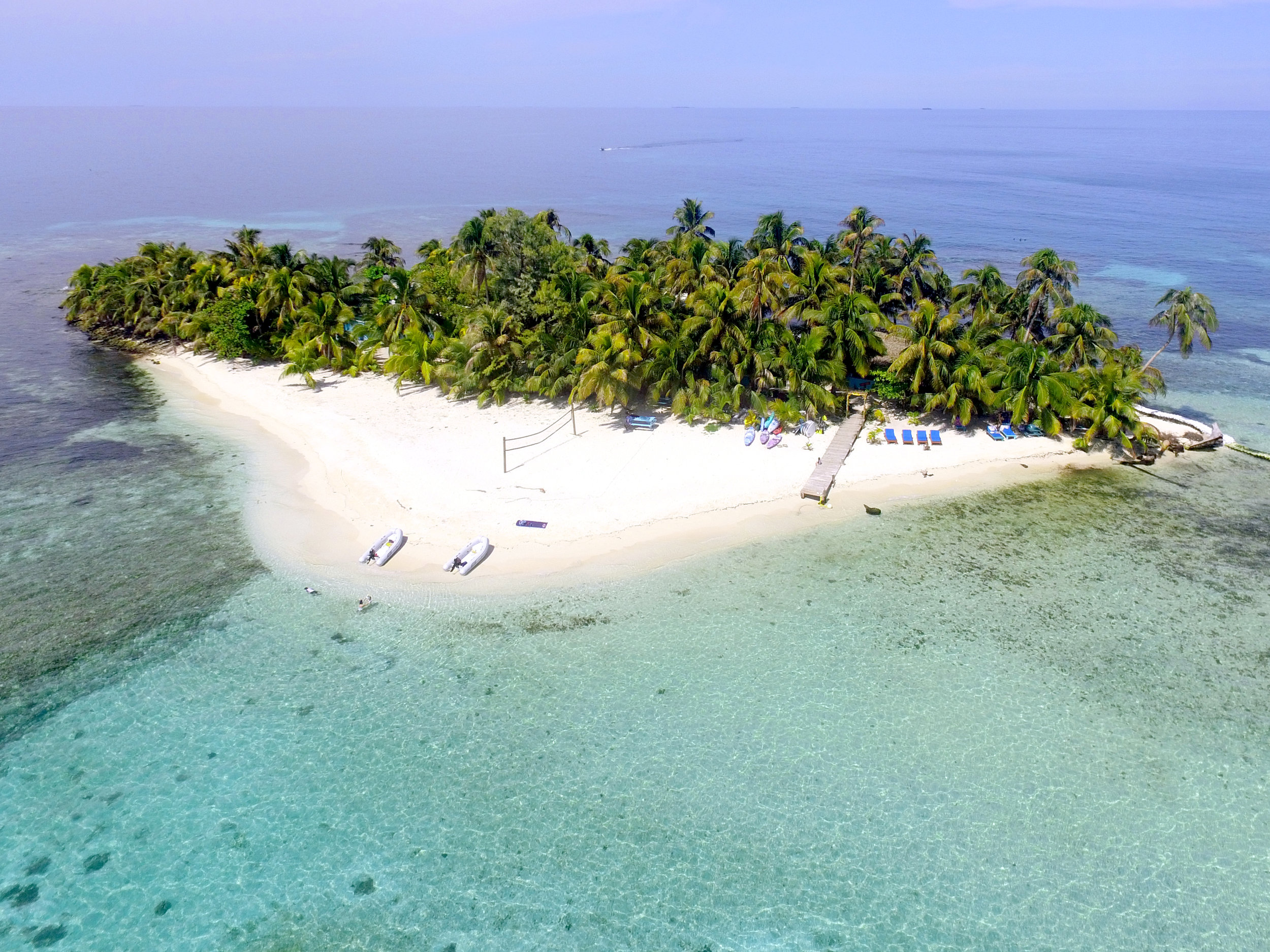Ranguana Caye Tropical Island Experience - A 2-acre, picture-perfect private island off the coast of Placencia, Ranguana Caye is the #1 area tour on Trip Advisor. Kids can snorkel around the island, play beach games, paddleboard or kayak, and so much more. Meals are always included!