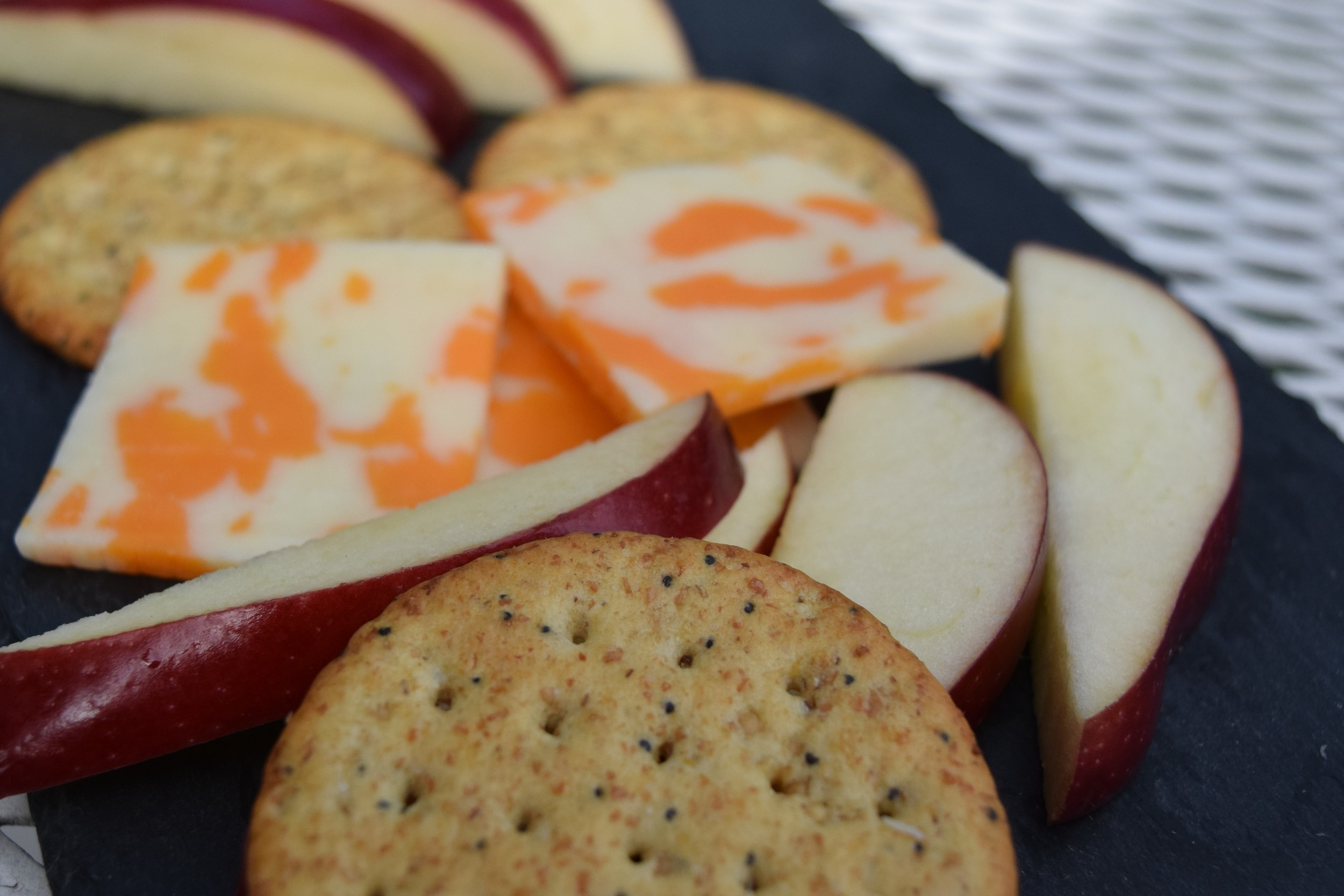 Crackers, cheese and an apple