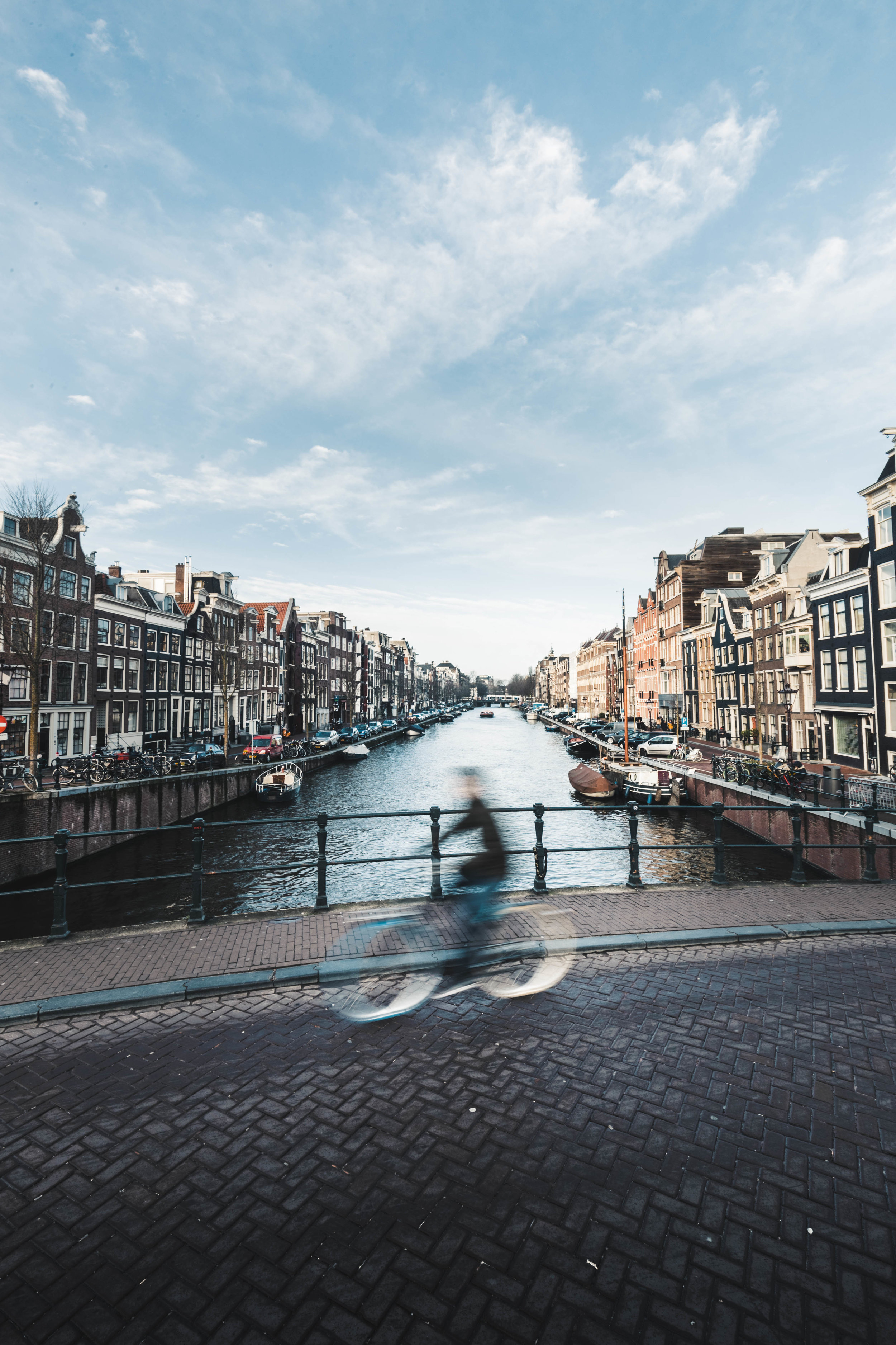 Amsterdam Netherlands man riding bicycle.jpeg