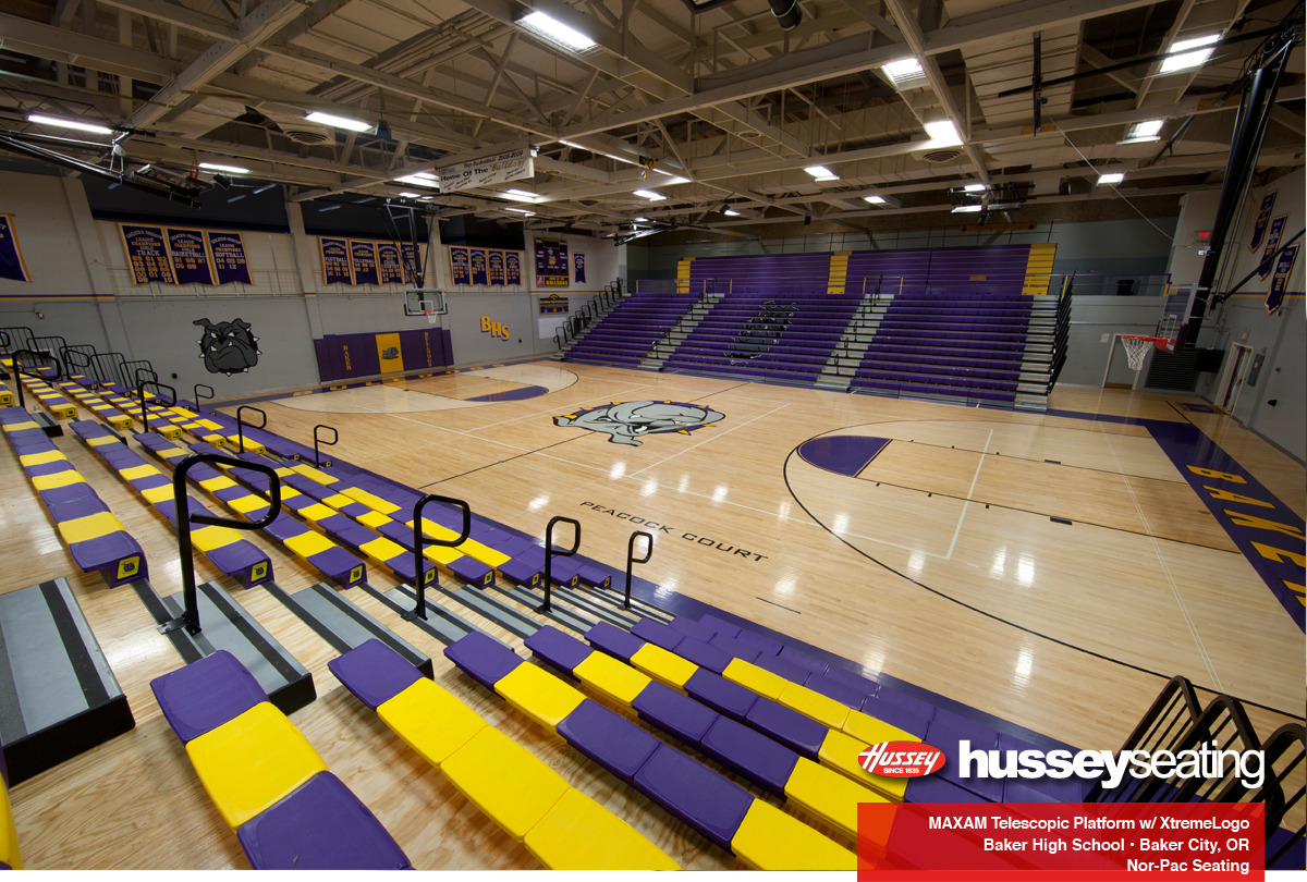 fbbcc6dce6b43 Baker High School wanted the whole package deal including two banks of  Hussey Maxam26 bleachers, a signature logo, an Xtreme logo, courtside  logos, ...