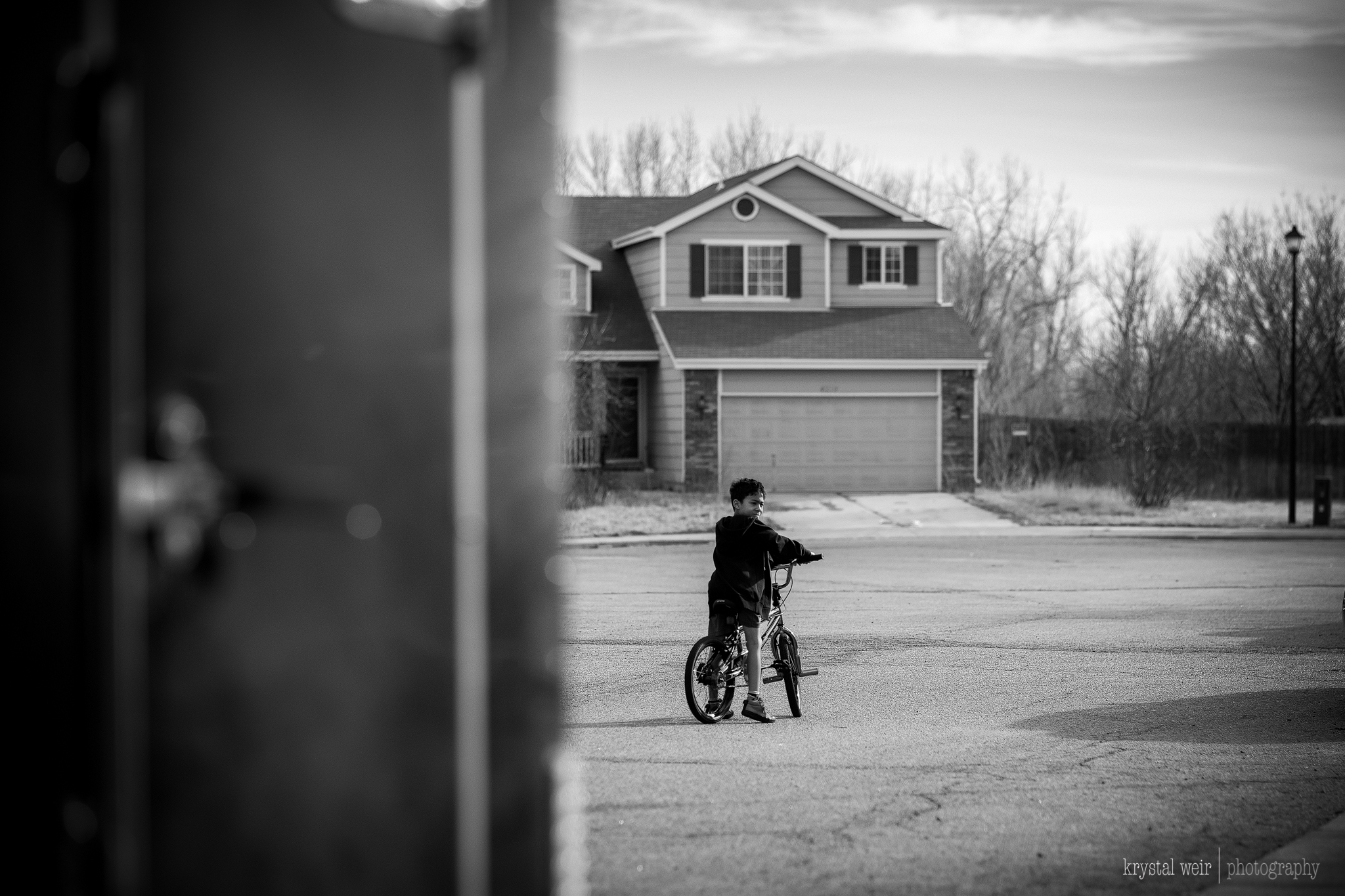 Day 29/365 When it's almost 60° outside in January, you not only make the kids #getoutdoors, but you get your butt out there too!    I was catching up to the kid and there was a trailer on the side of the road and I decided to use it to frame my son. I wanted to edit this photo in color, but my edits were not turning out the way I envisioned so my go to was a b&w edit.