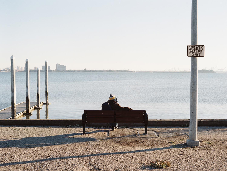 Man on a pier Berkeley, CA, 2013