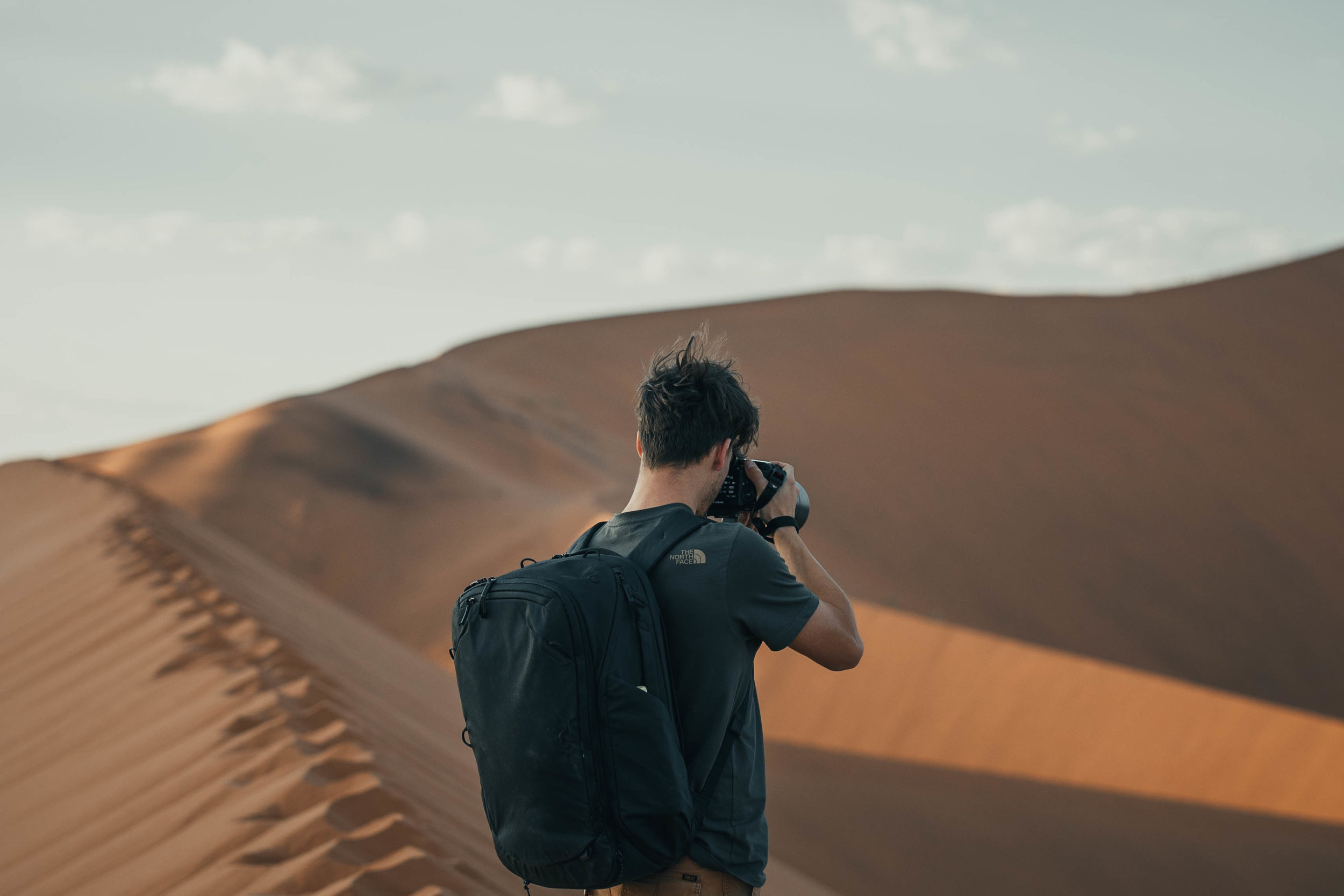 Capturing the beautiful Namibian desert with my trusty backpack