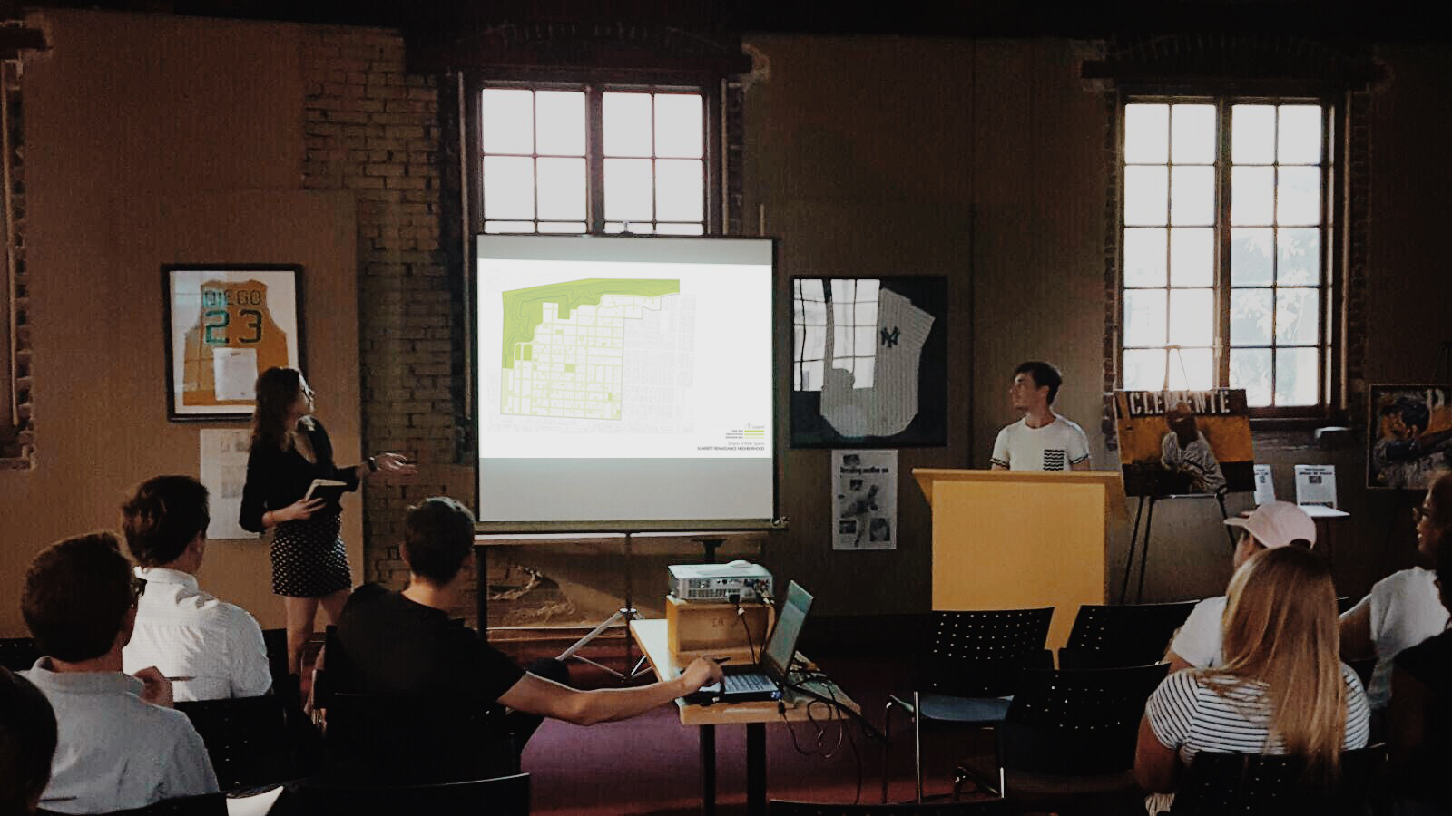 Kylie Schwaller and Travis Snell present various maps and diagrams to explain the studio's data and discoveries about the Scarritt Renaissance neighborhood.