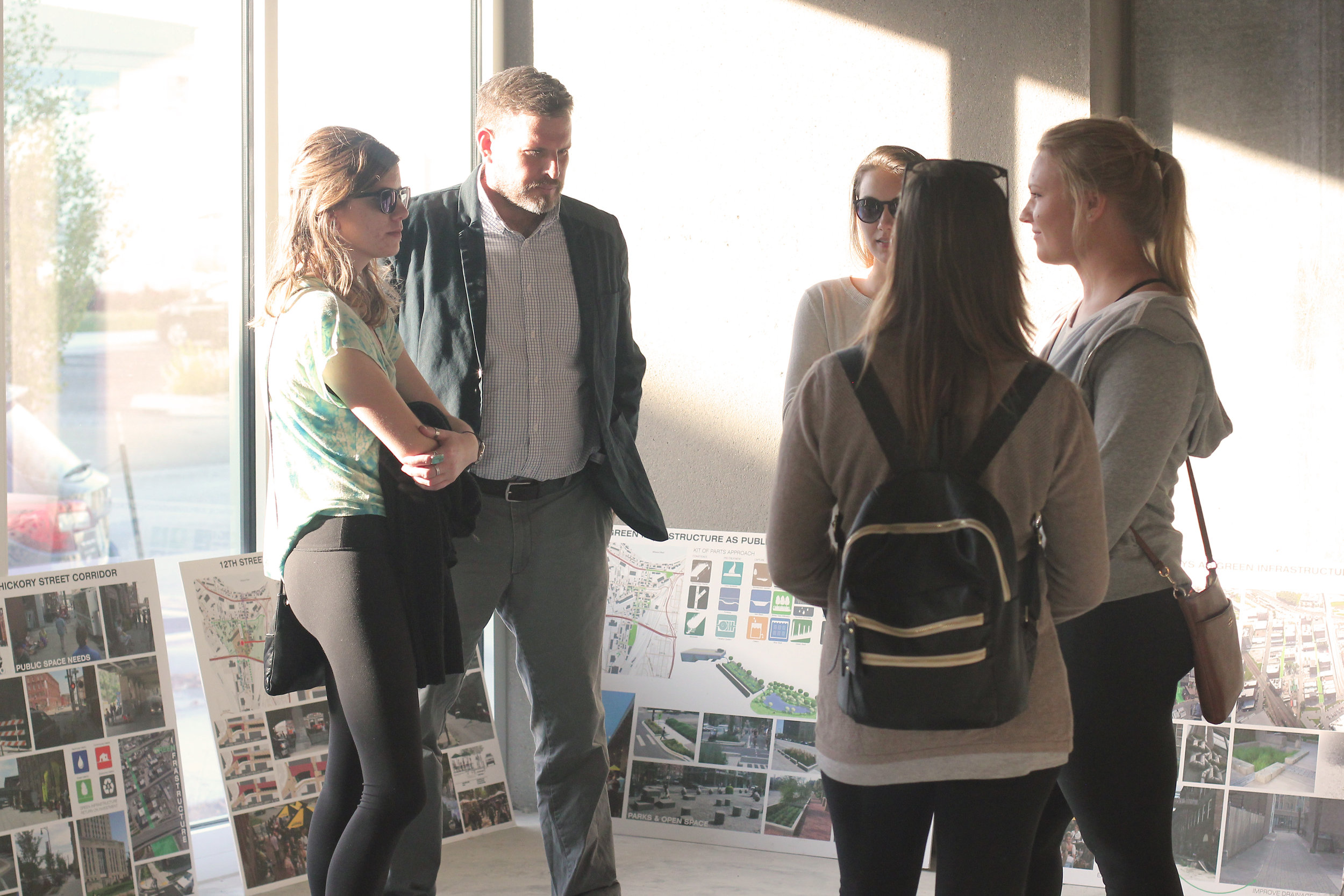 KCDC students visited a public meeting on Phronesis and KEM Studio's proposed Streetscape Plan and Wayfinding Plan for the West Bottoms in preparation for their next studio project.