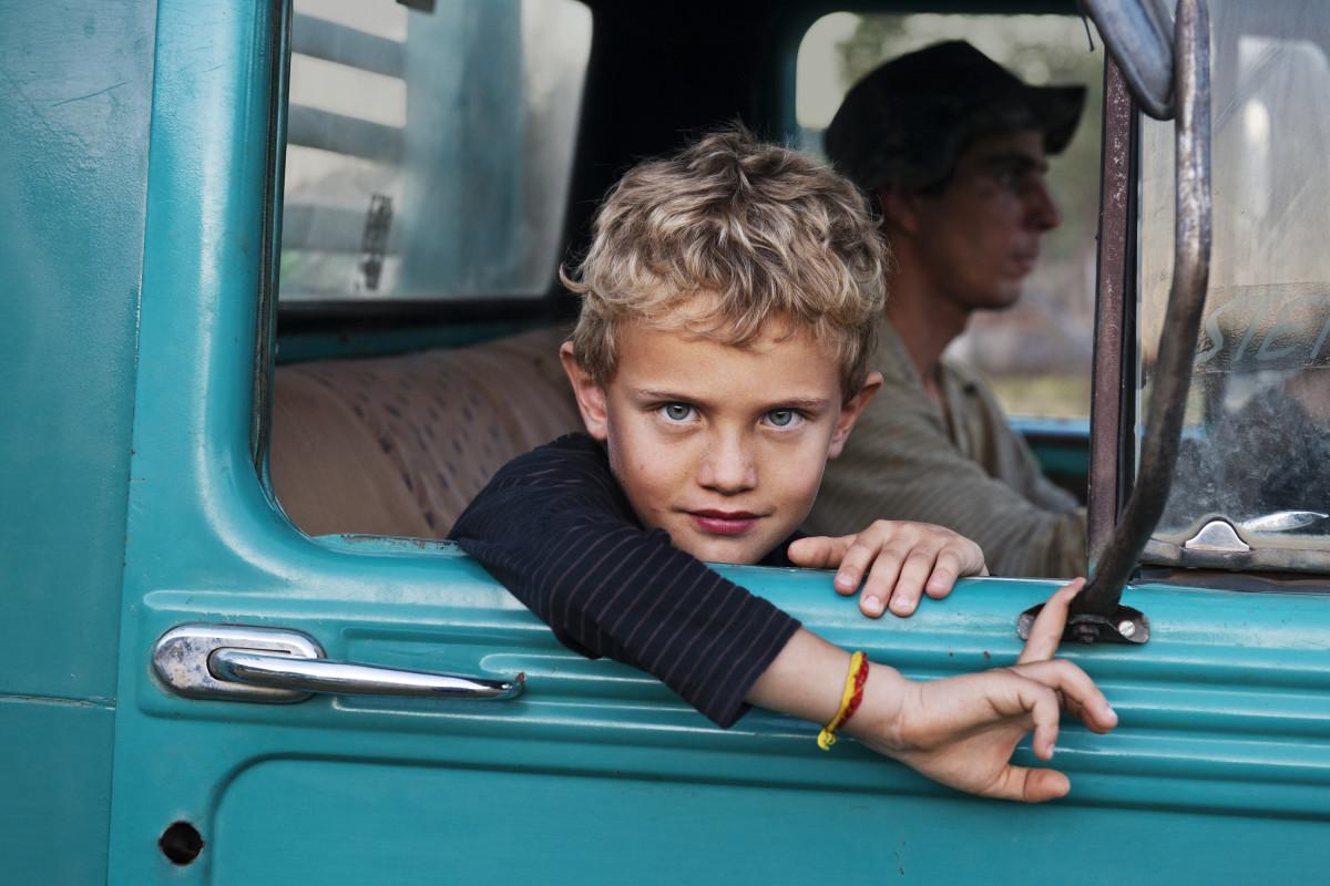 Steve McCurry, Lambari, Brazil', 2010. A Farmer's Son in his Father's Truck.