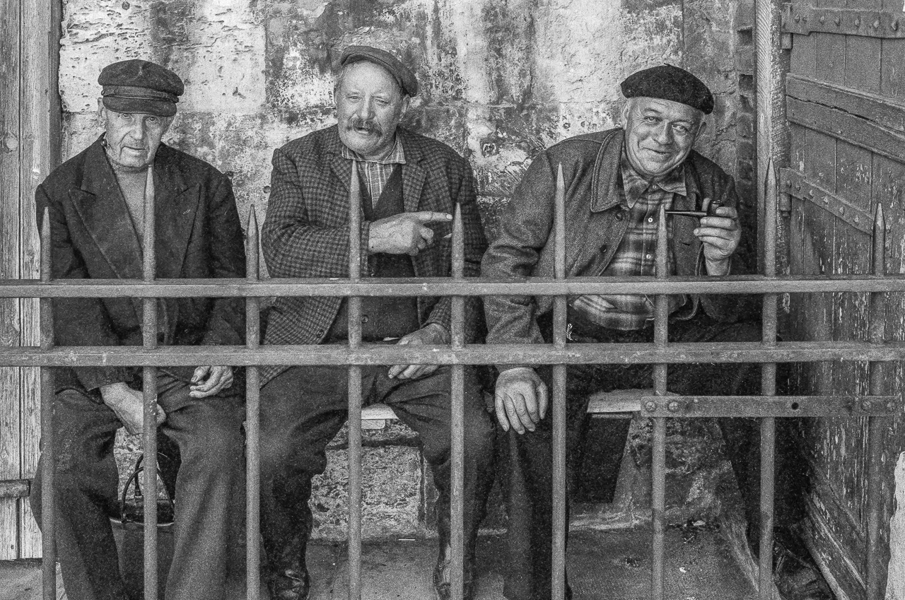 Three French Fishermen Sharing an In-Joke