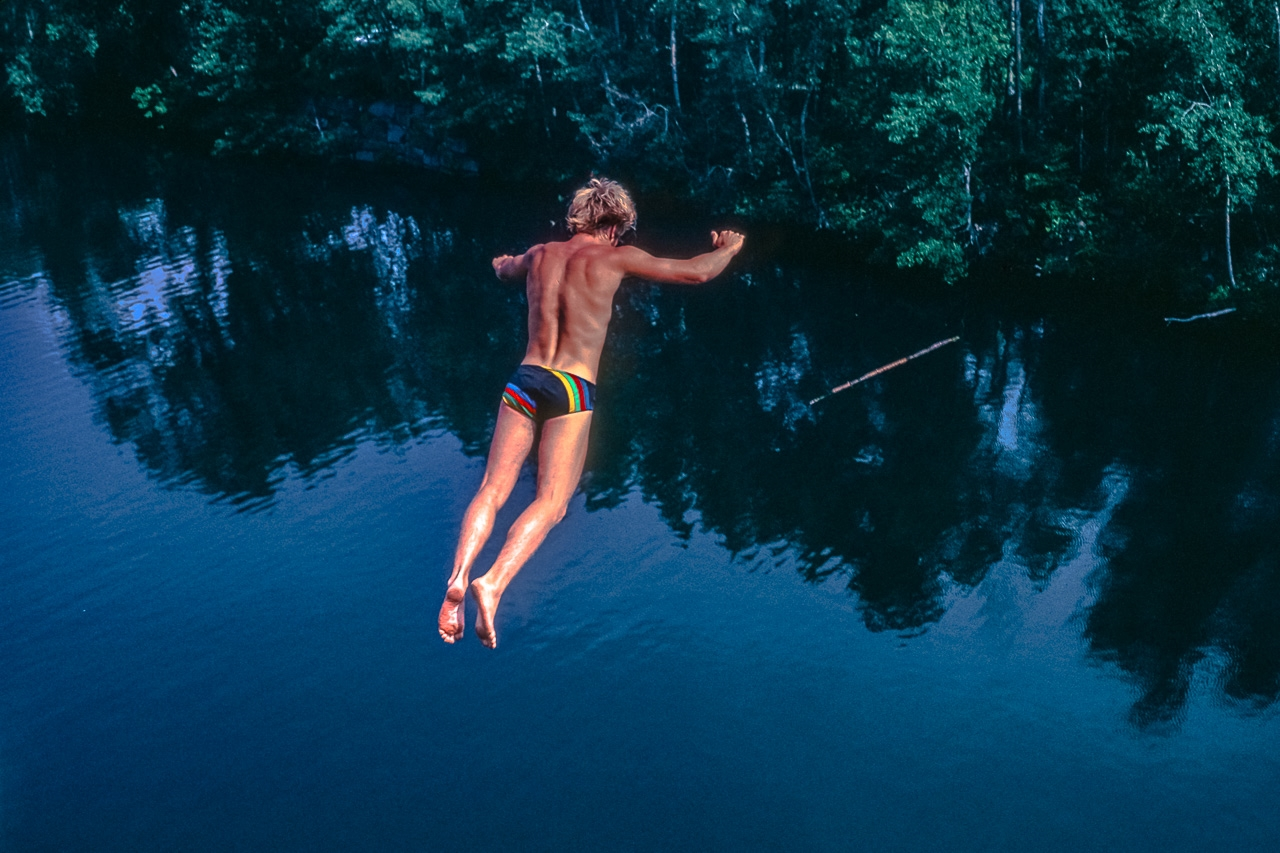Daring Cliff Diver Soars In Flight