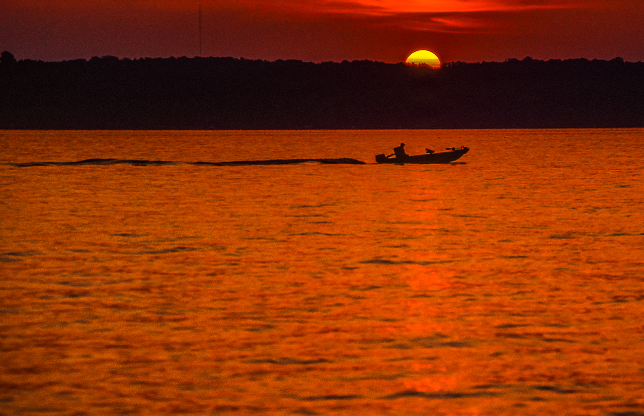 Lone Fisherman Heads Home At Sunset, Green Lake, Wisconsin