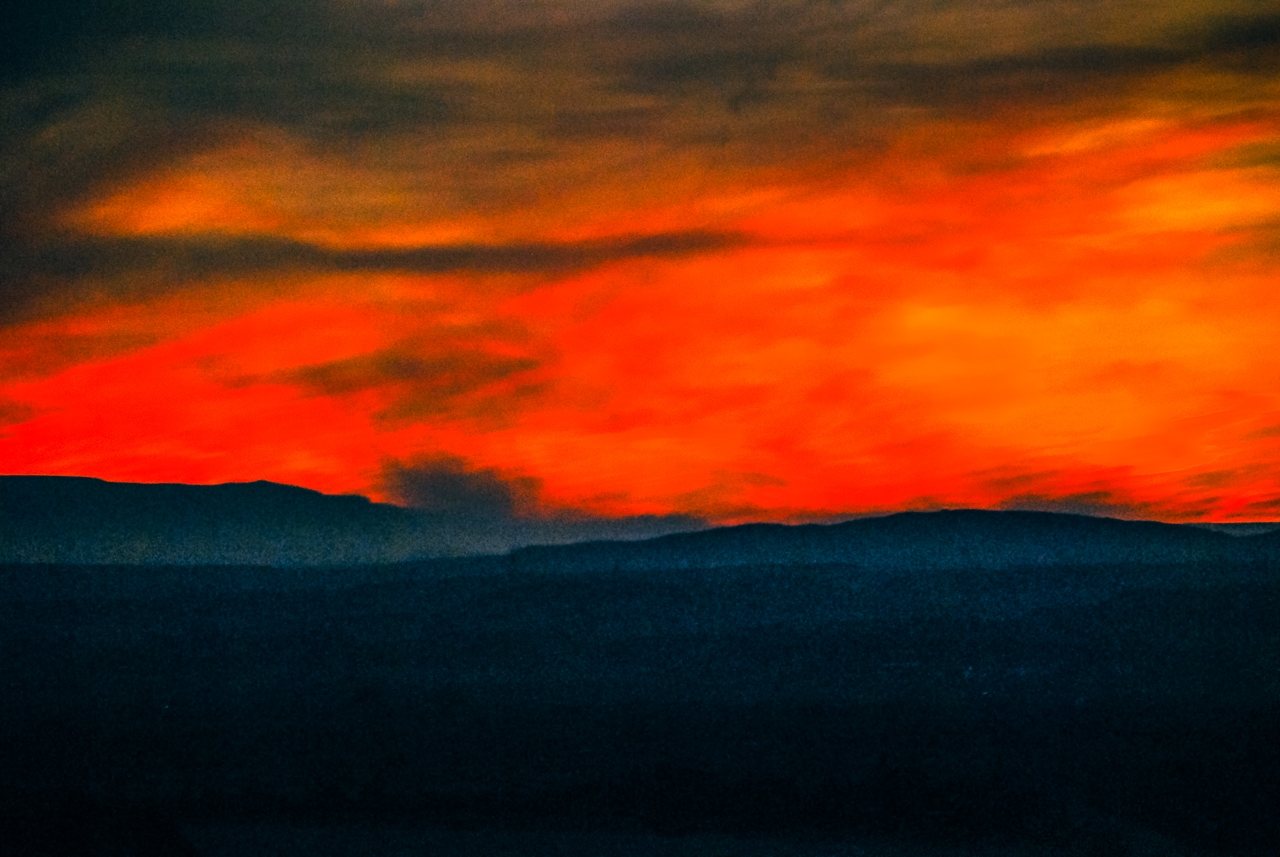 Fiery Skies as Forest Fire Shadows Sunset