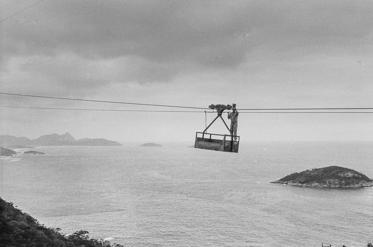 Cable Car Repairman Working On Cable To Sugar Loaf Mountain, Rio de Janeiro, Brazil