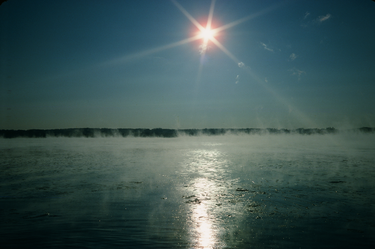 Starburst Sun Over Steam As Deep Lake Meets Freezing Air