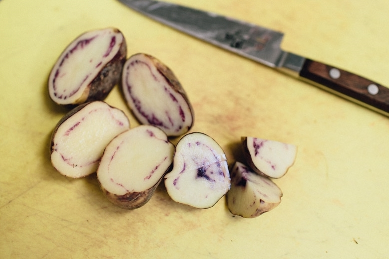 Purple streaks are naturally occurring due to the high altitude in which these local heirloom potatoes grow. Used in dishes like the chicken hearts pictured earlier.