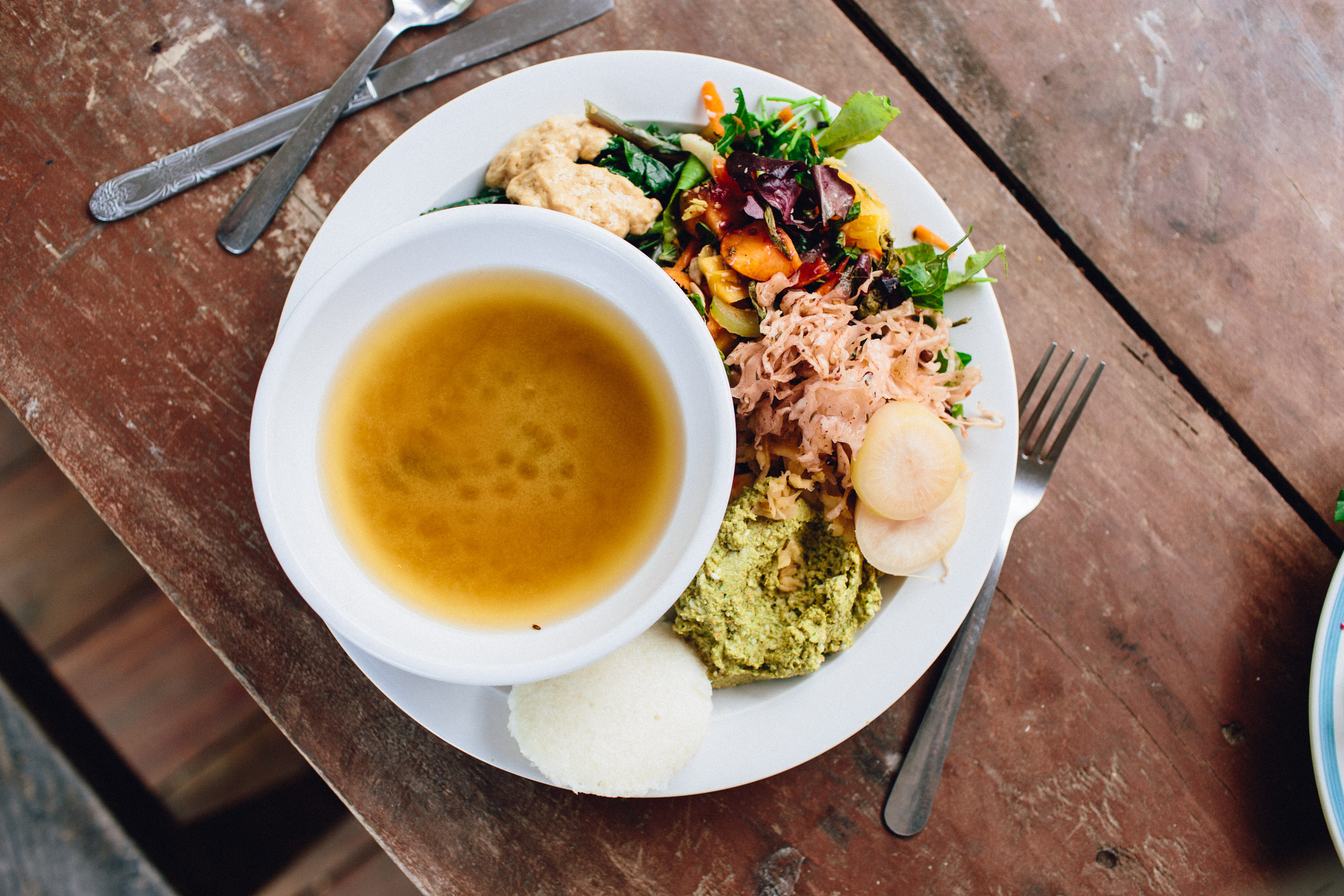 Sandor made us Miso soup for lunch. Also on the plate: idli, nut & veggie paté, garden salad, sautéed greens, and sauerkraut.
