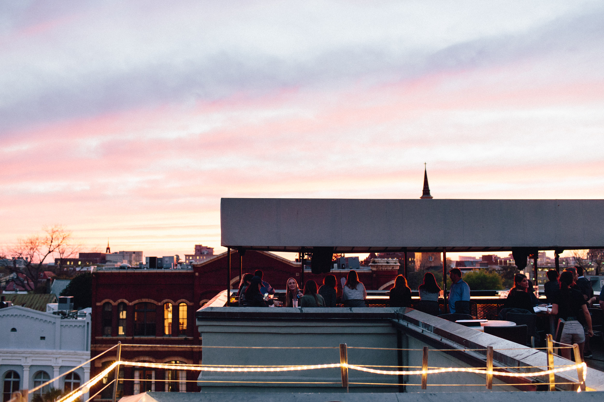 After the beautiful dinner at  The Drawing Room , we conveniently headed upstairs to  The Vendue's rooftop bar  for some cocktails, and more importantly, splendid Charleston sunset views. If you don't get on a rooftop at sunset in Charleston, you did something wrong. You GOTTA.
